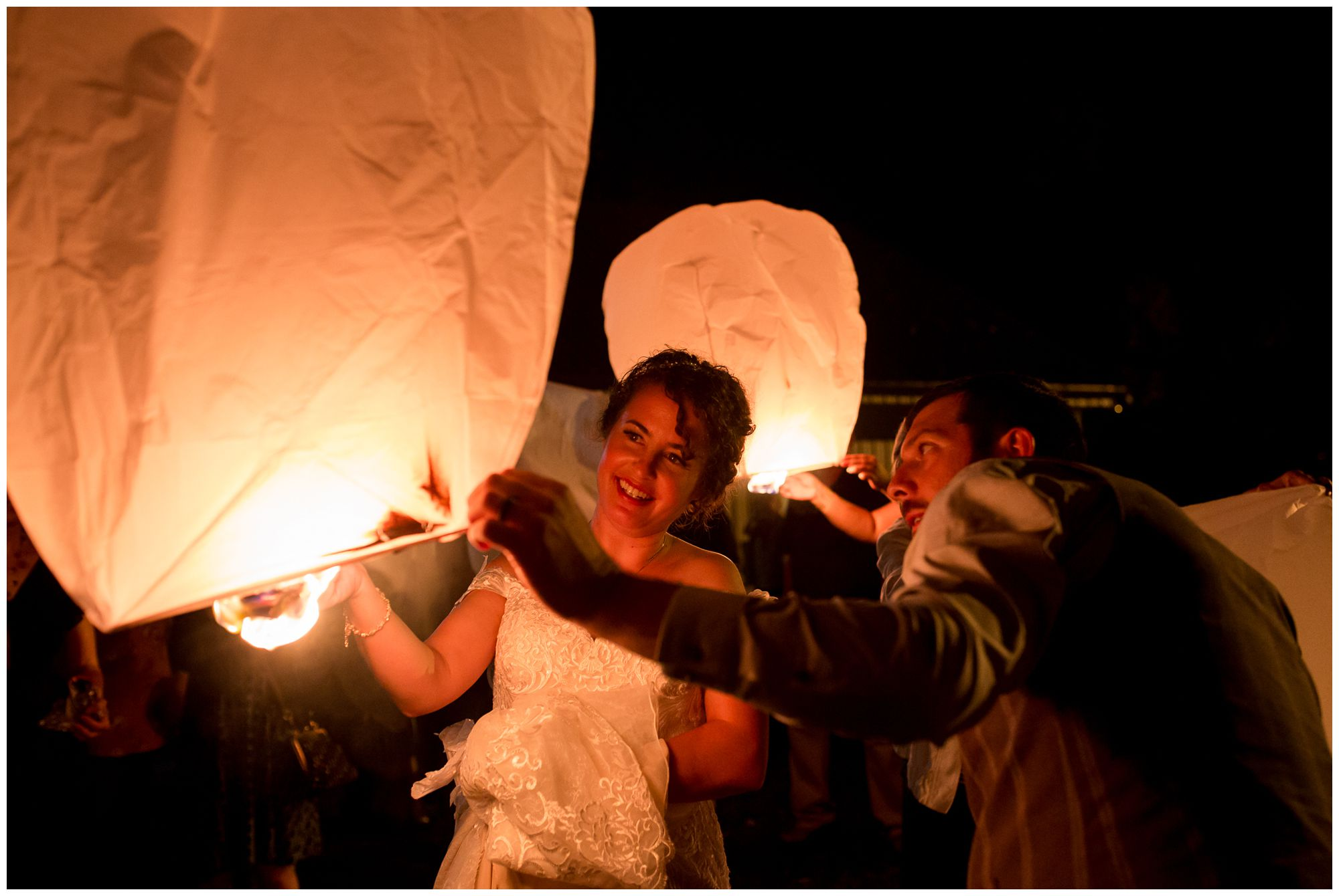 bride and groom release Chinese lantern during Peru Indiana wedding reception