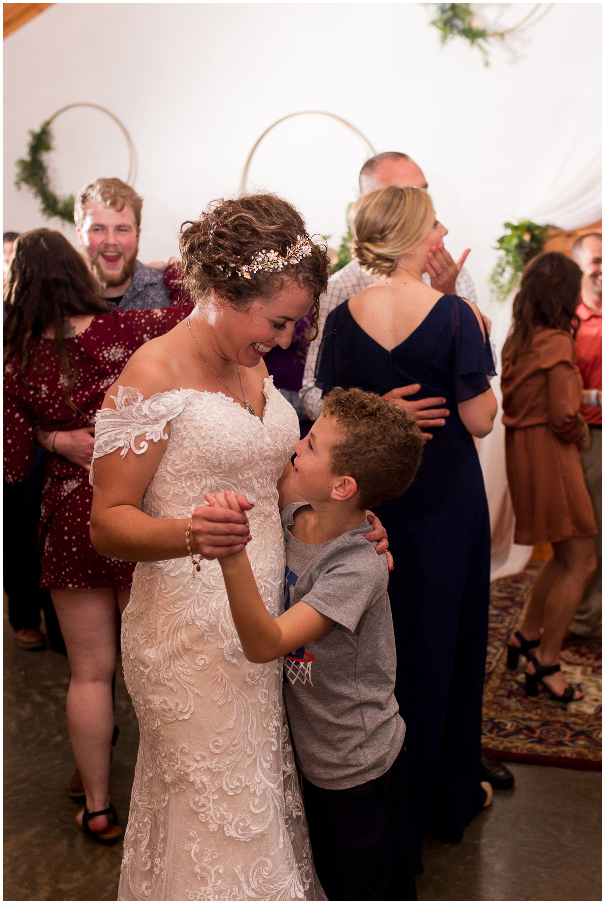 bride dances with son during wedding reception at Western Howard Conservation Club in Peru Indiana