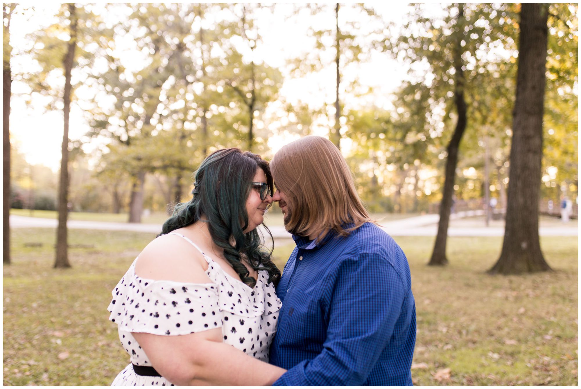 husband and wife with foreheads together during Indianapolis anniversary session at Holcomb Gardens