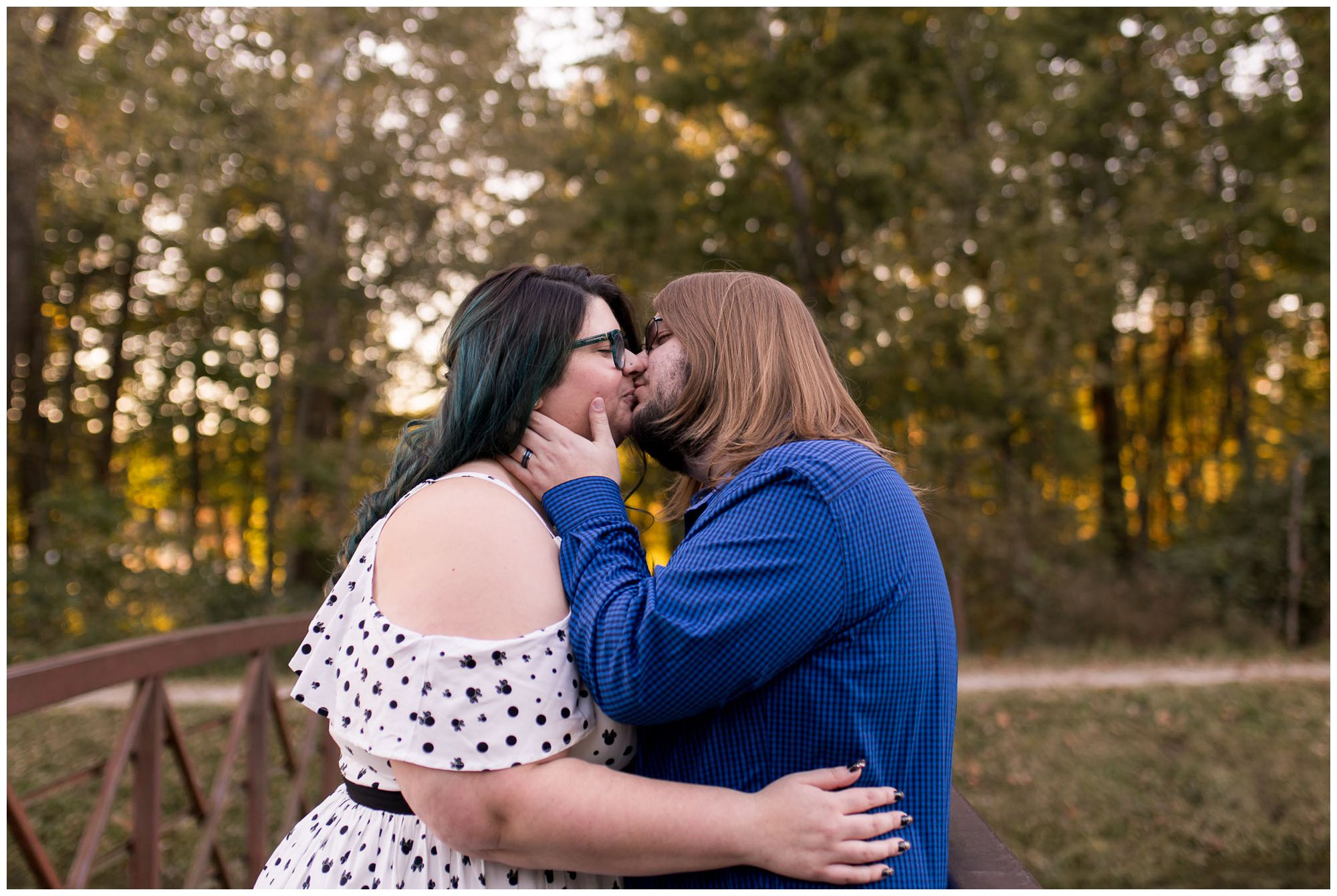 husband and wife kissing during Holcomb Gardens anniversary session in Indianapolis
