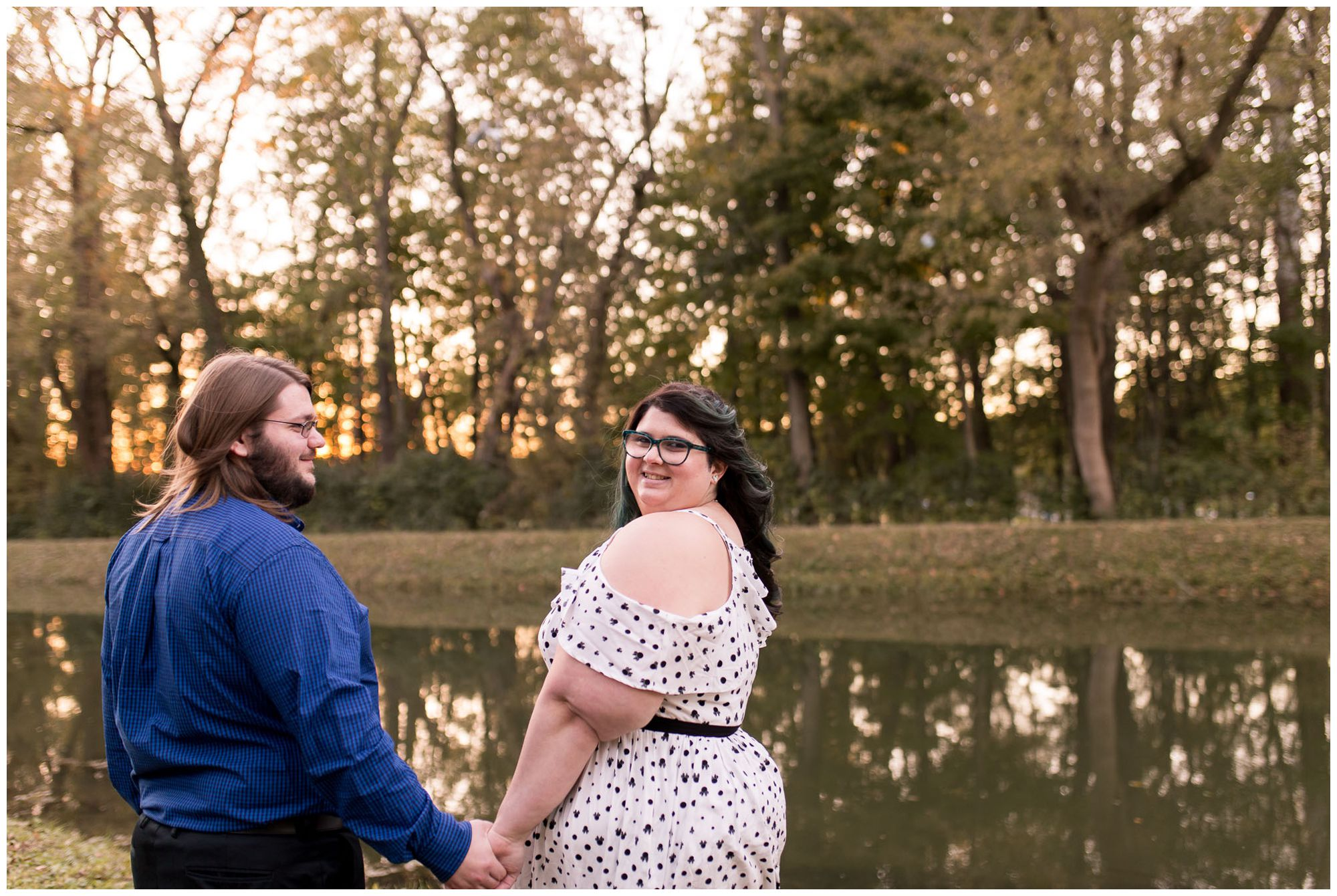 wife looks back at camera during anniversary session at Holcomb Gardens in Indianapolis