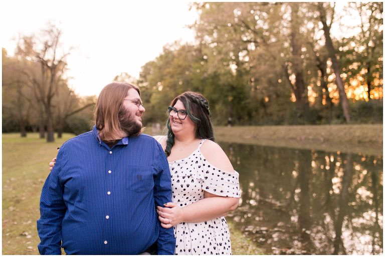 wife smiles at husband during Holcomb Gardens engagement session in Indianapolis