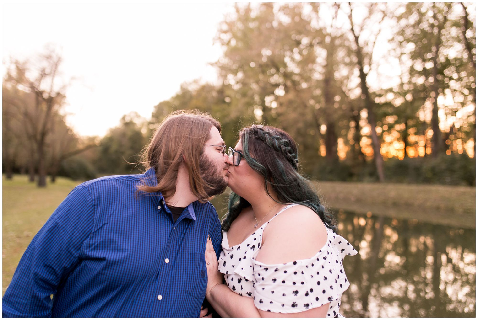 wife and husband kiss during anniversary session at Holcomb Gardens in Indianapolis