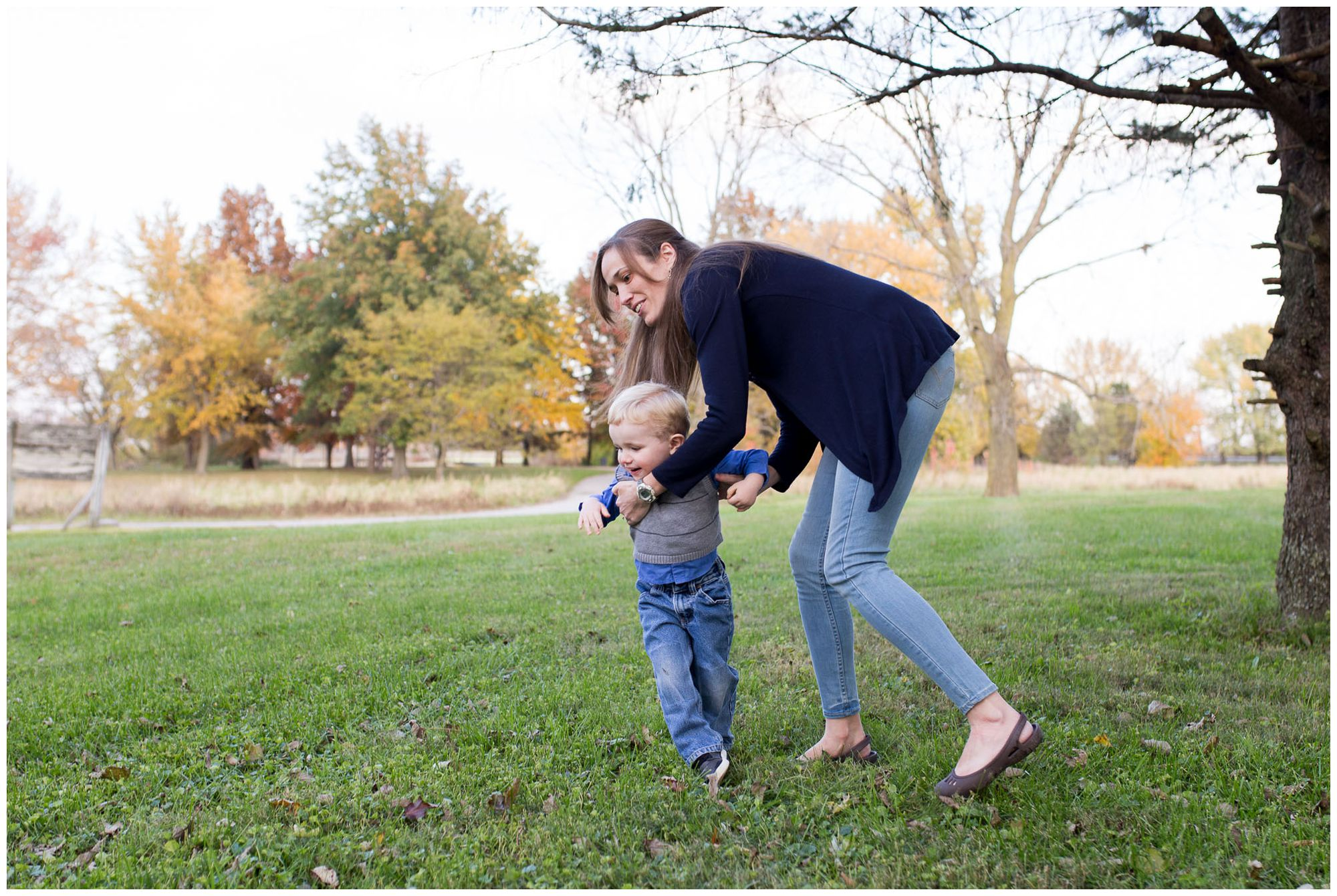 mom spins son around during family session in Kokomo Indiana