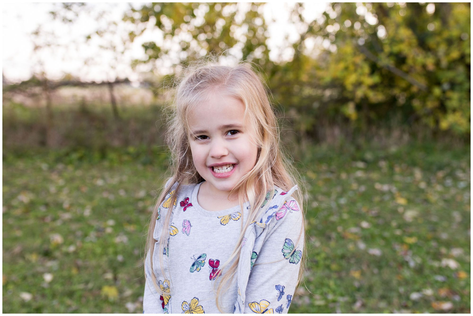little girl portrait pose during family session in Kokomo Indiana