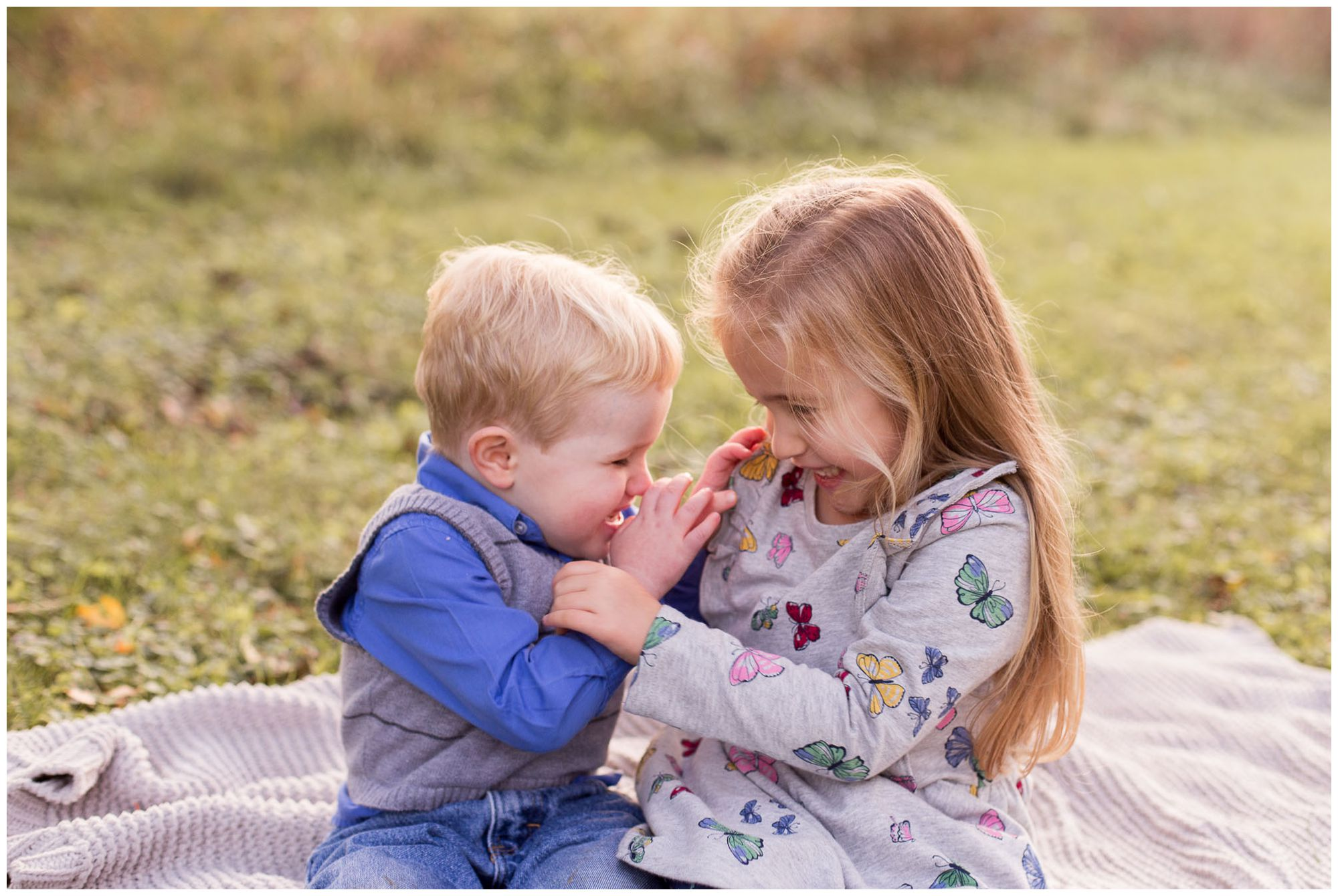 brother and sister tickle each other during Kokomo family session