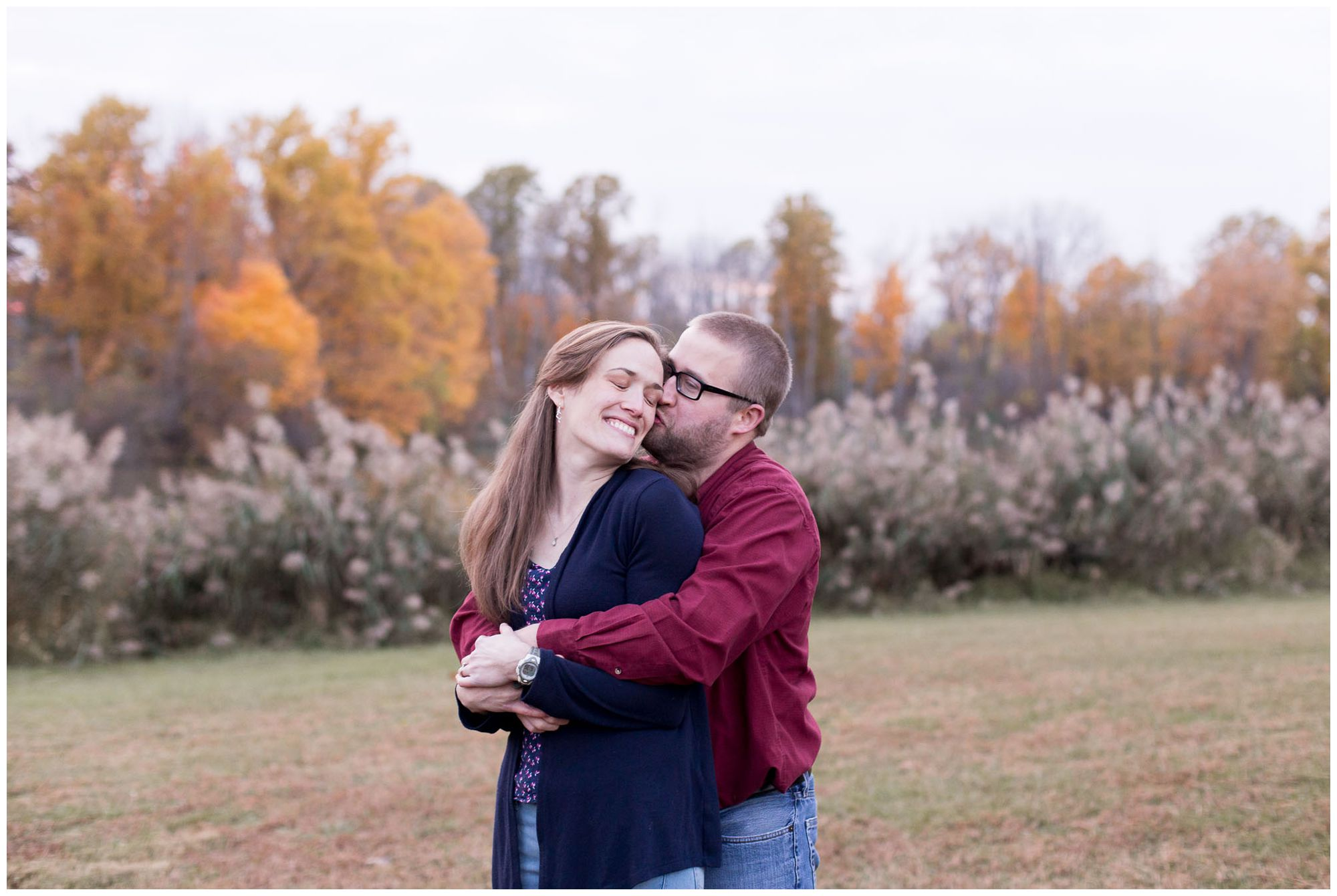dad kisses mom on the forehead during Kokomo family session