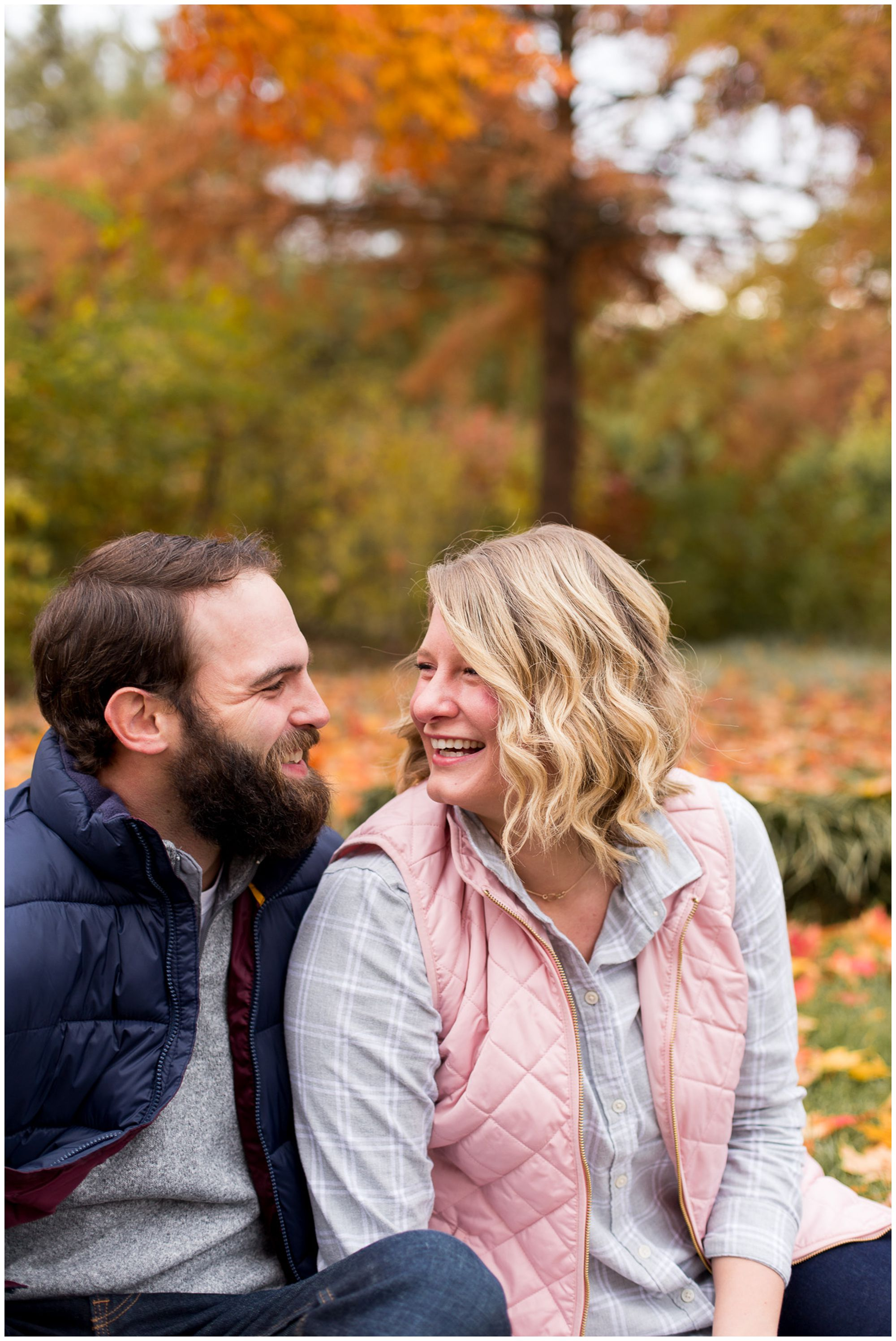 bride and groom laugh together during downtown Fort Wayne engagement session at Headwaters Park