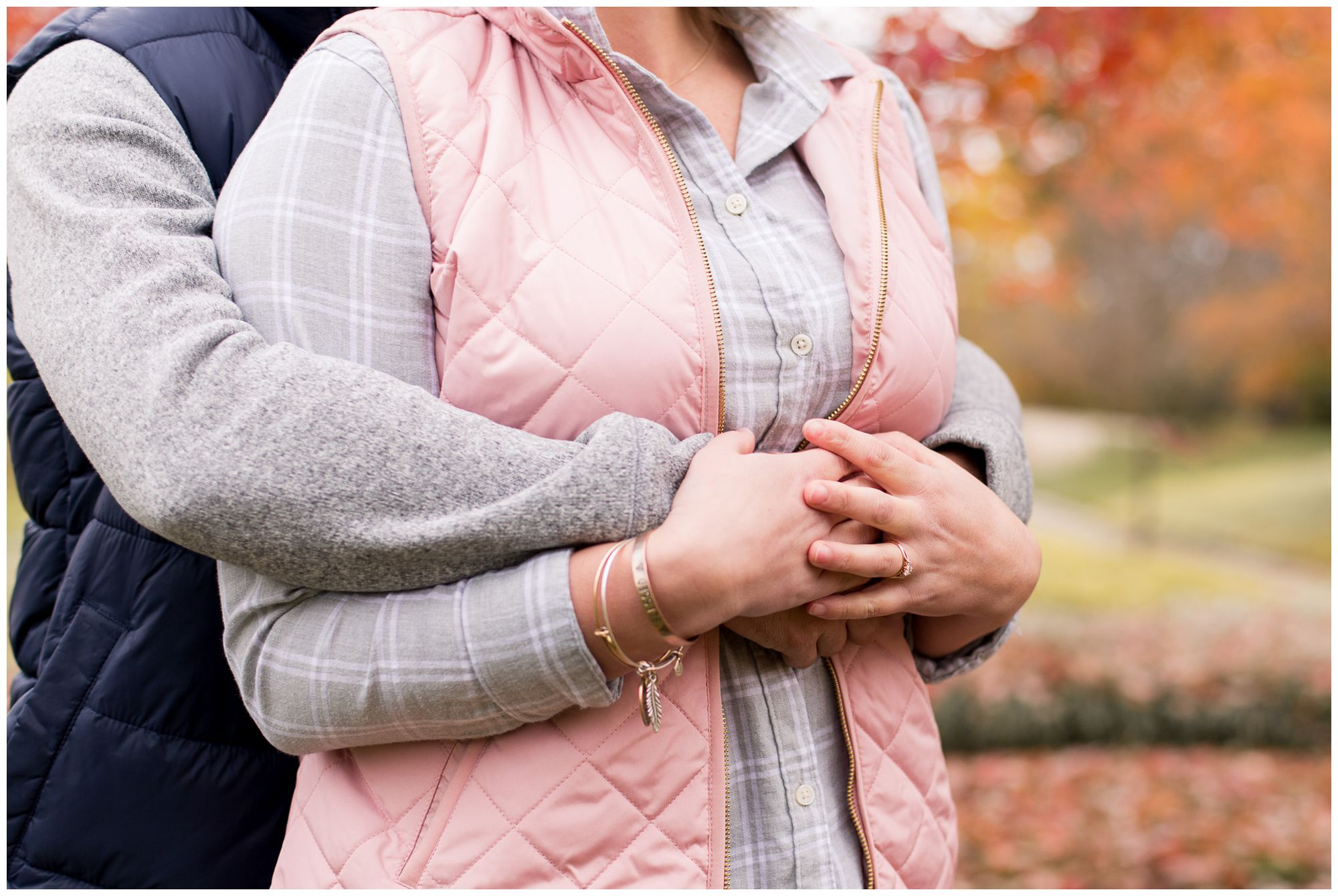close up of bride and groom's hands around bride's waist during fall Fort Wayne Indiana engagement session