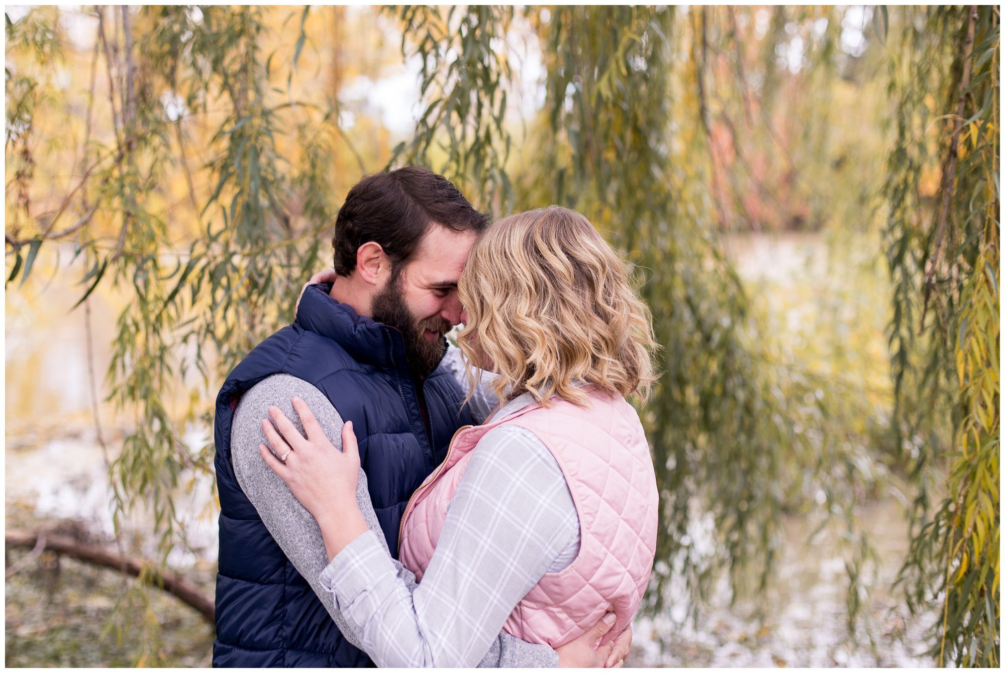 bride and groom go nose to nose during engagement session in downtown Fort Wayne
