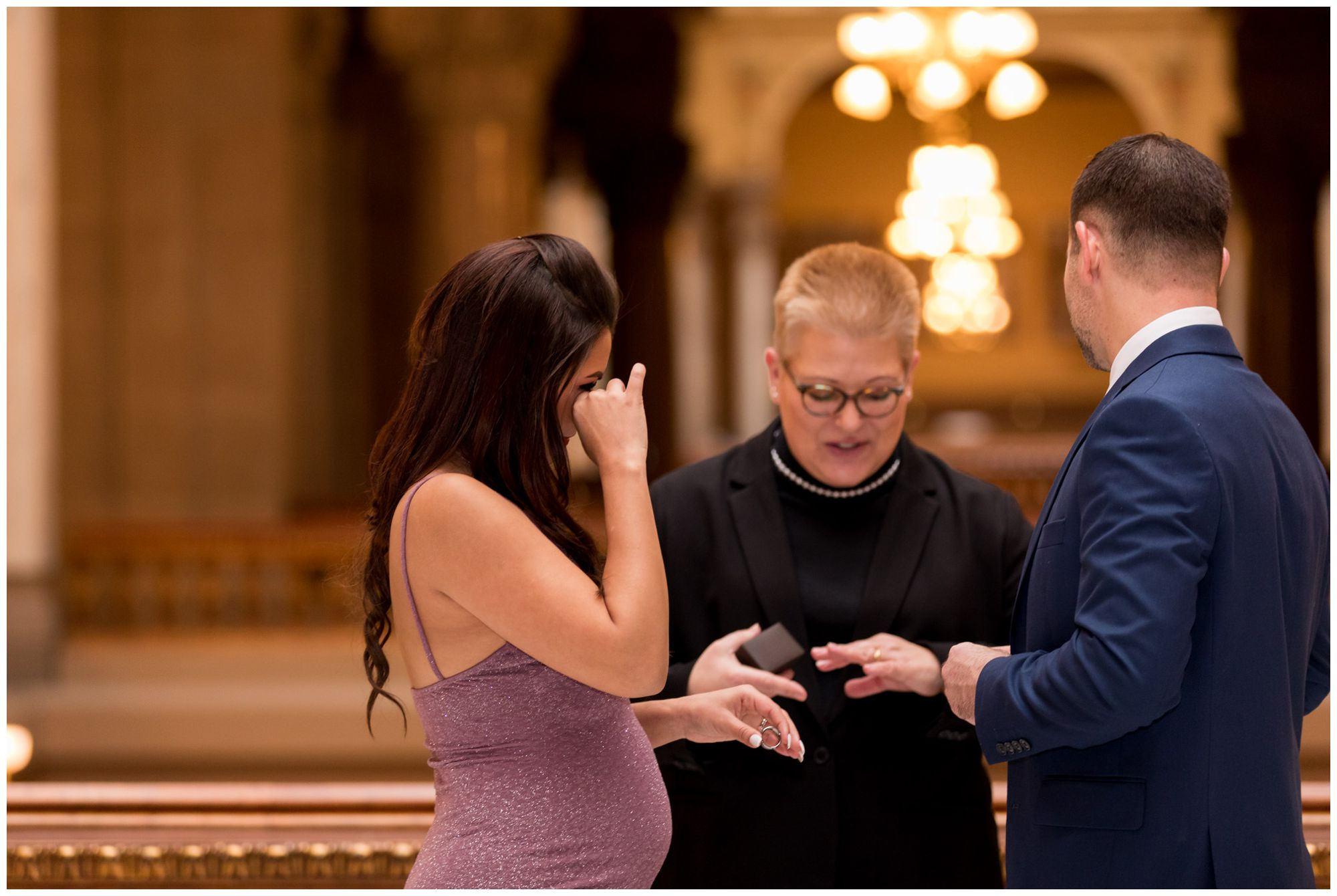 bride wipes away tears during downtown Indy elopement ceremony at Indiana Statehouse