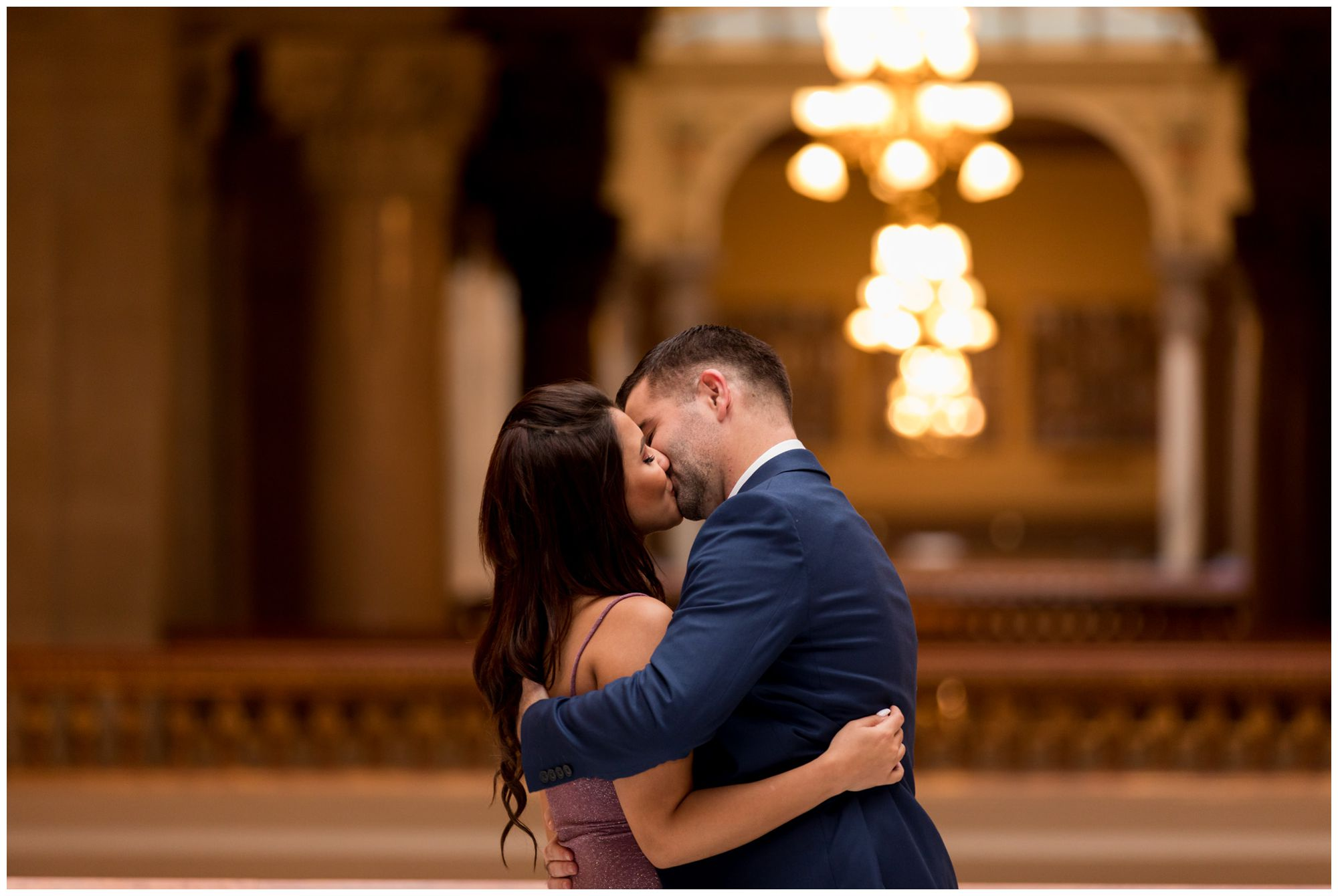 bride and groom first kiss during Indiana Statehouse elopement in downtown Indianapolis