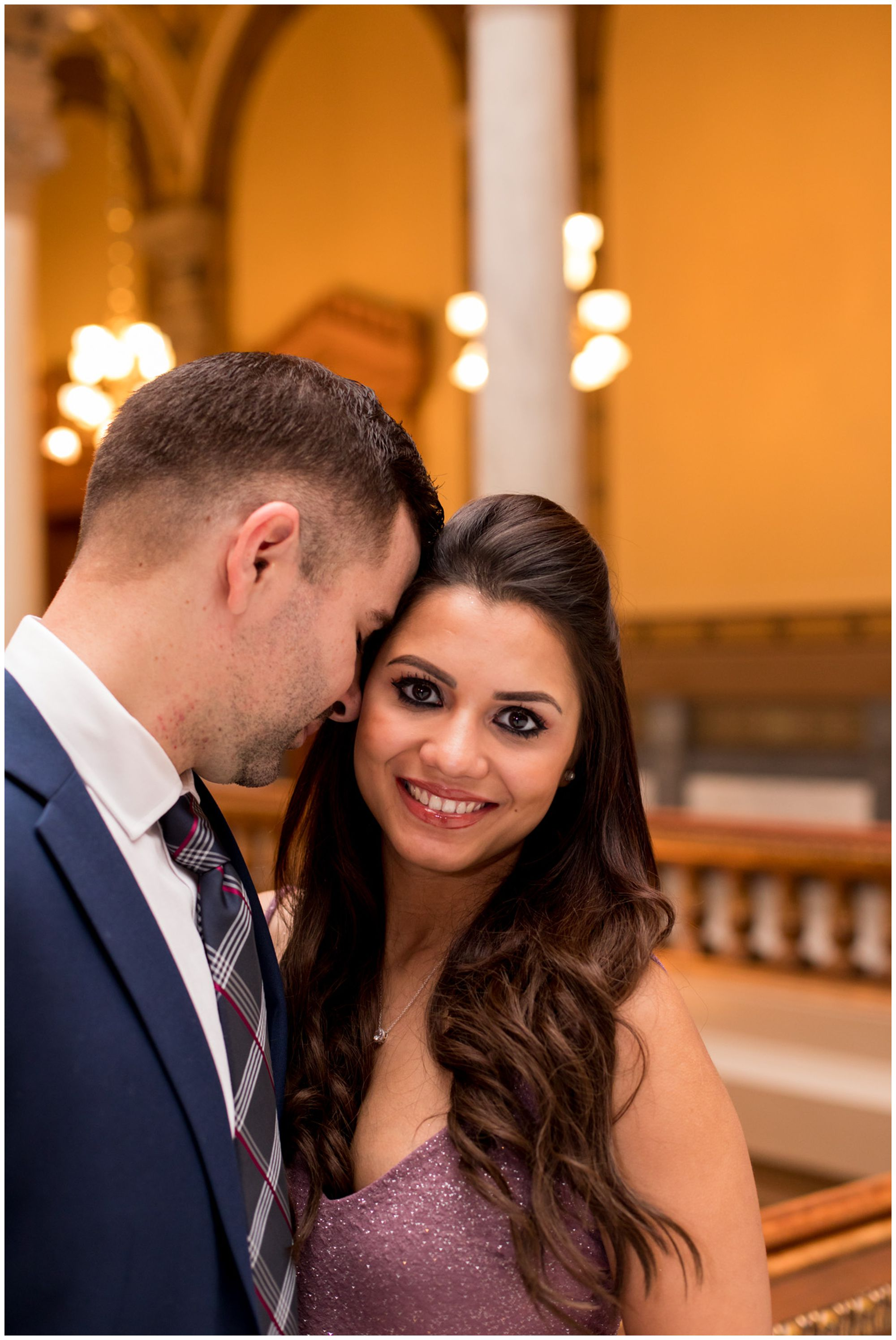 bride looks at camera during couples portraits after elopement ceremony at Indiana Statehouse