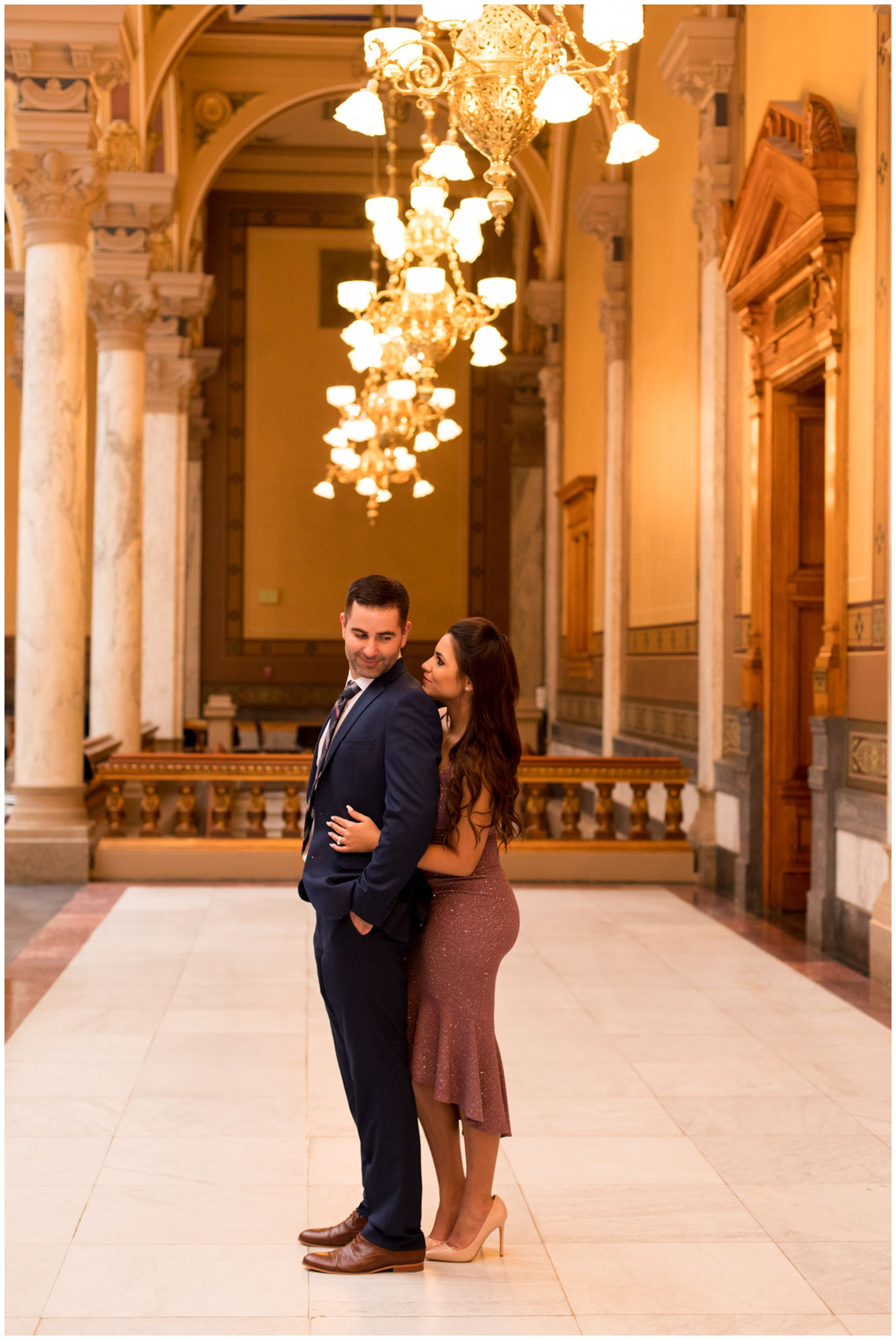 bride looks at groom during couples portraits after Indiana Statehouse elopement ceremony