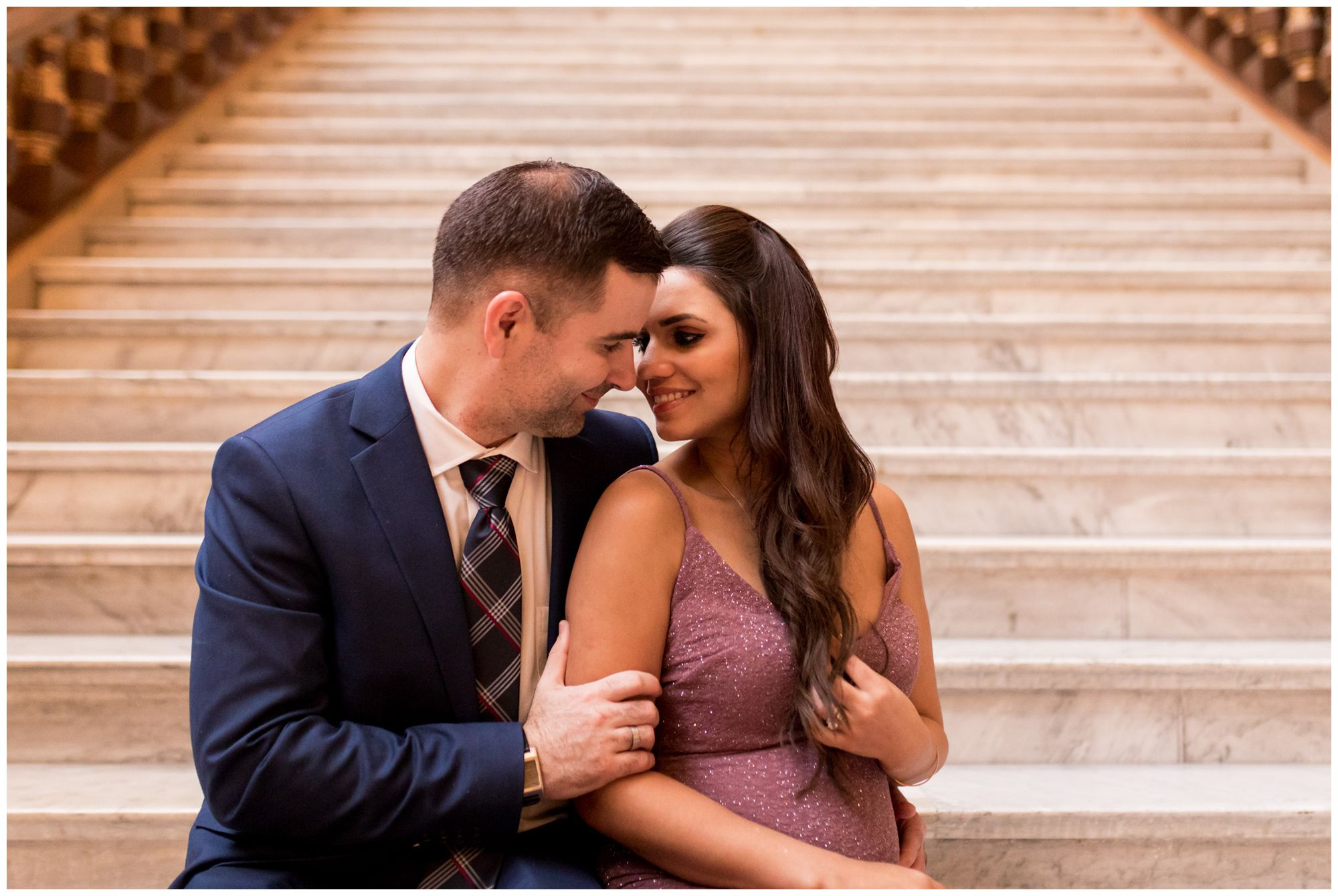 bride and groom snuggle on steps in Indiana Statehouse after downtown Indianapolis elopement