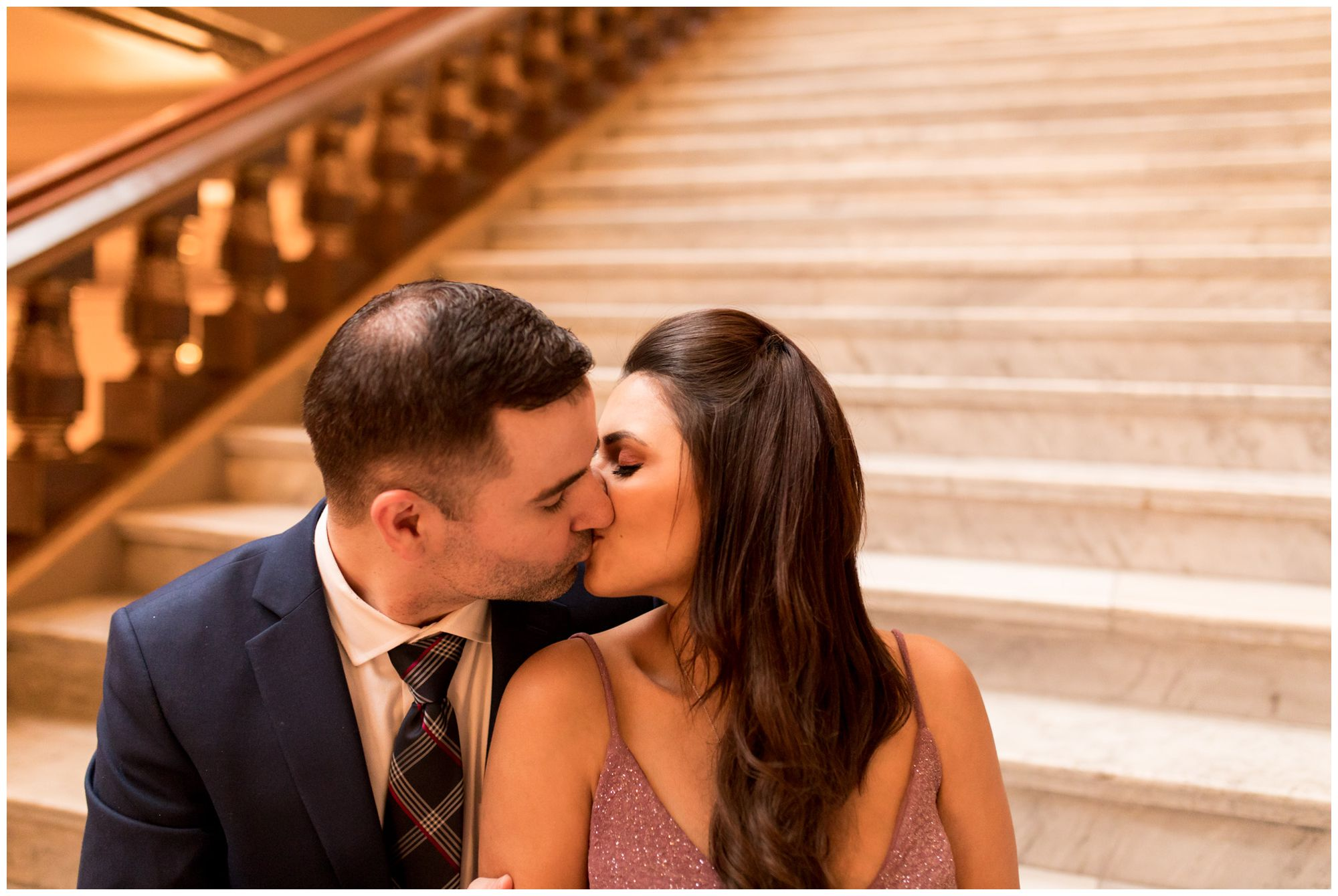 bride and groom kiss on steps in Indiana Statehouse after downtown Indianapolis elopement