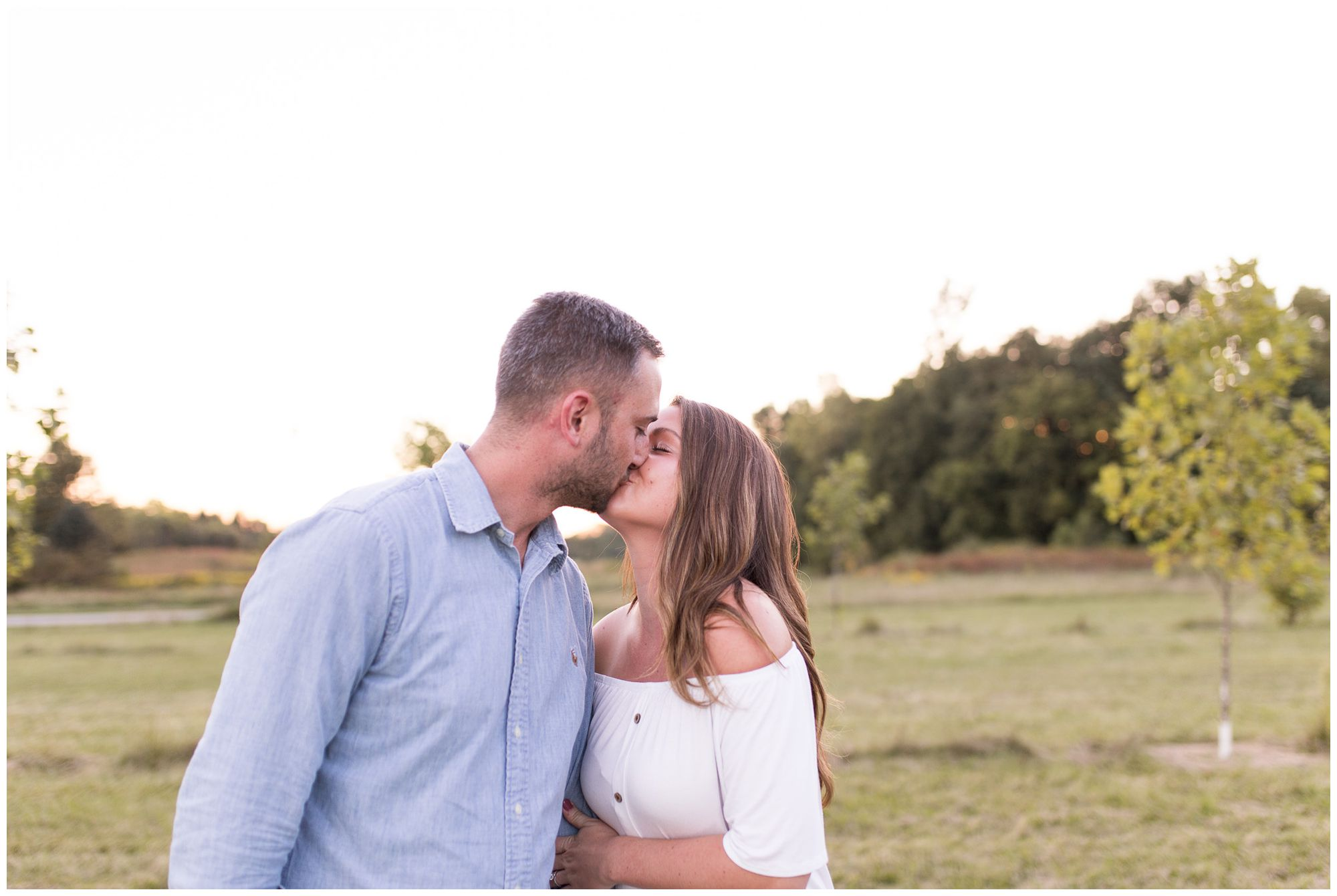 couple kissing during engagement session at Metea County Park in Fort Wayne Indiana
