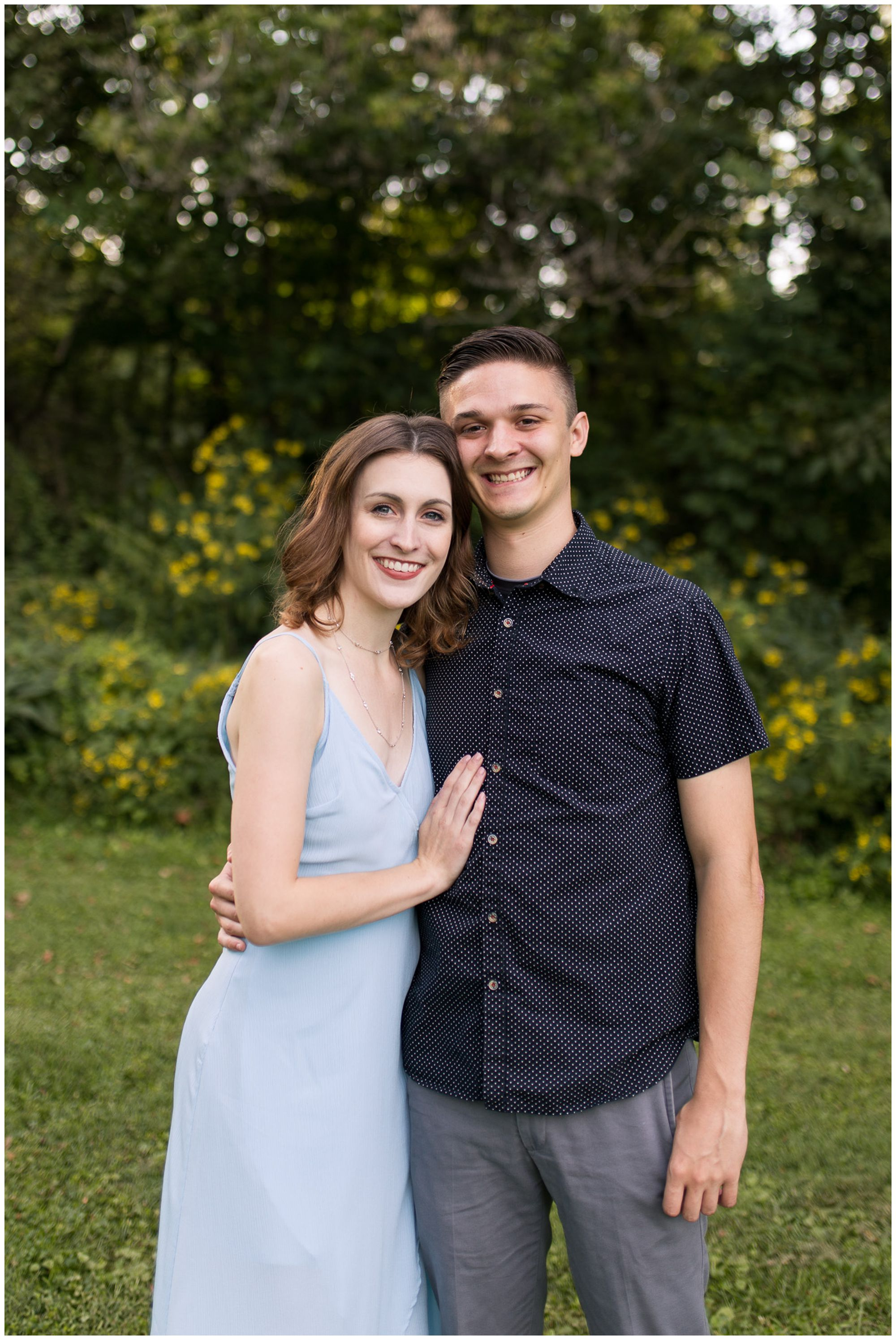 bride with hand on groom's chest during Fort Wayne engagement session at Foster Park