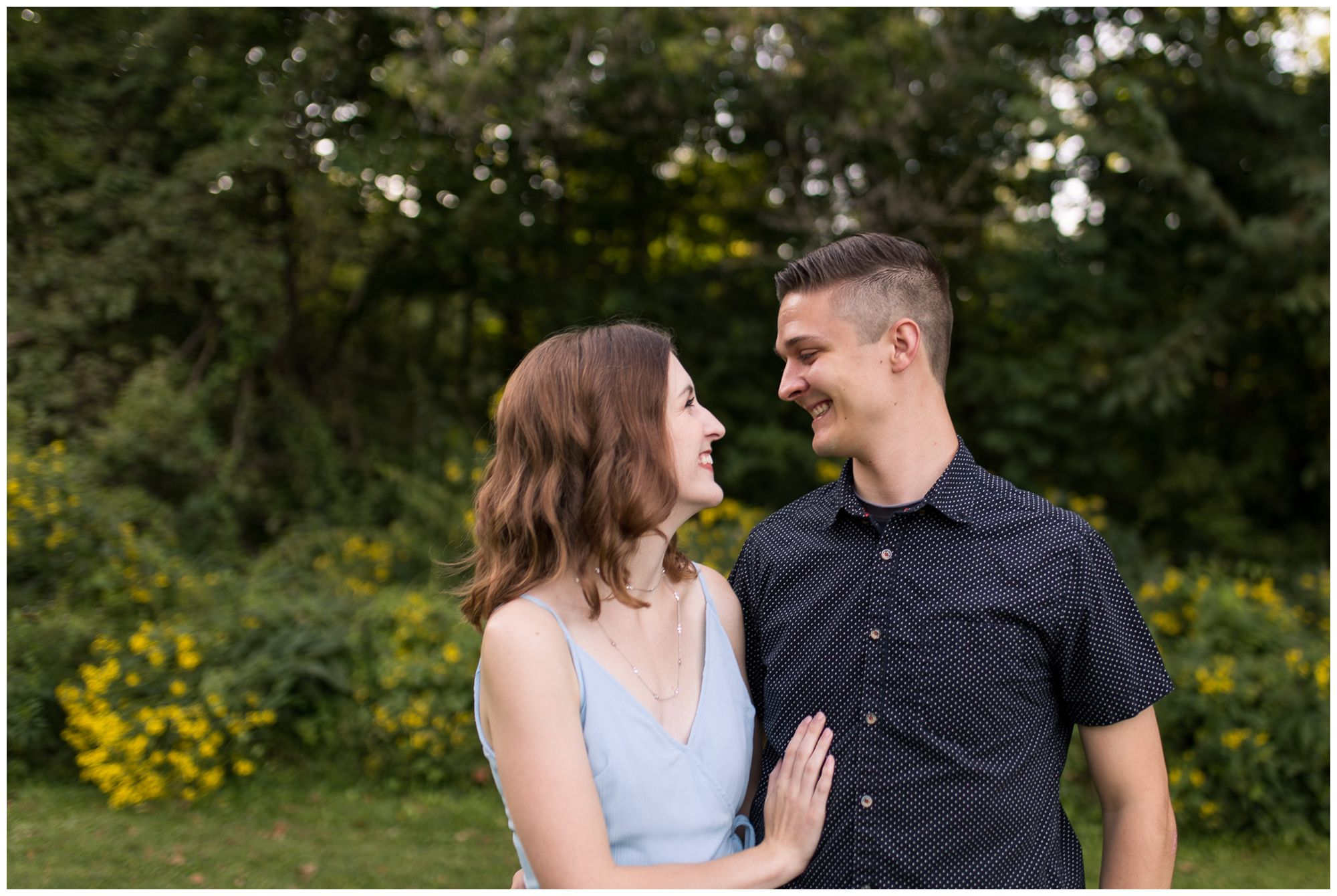 bride and groom look at each other during Foster Park engagement session in Fort Wayne