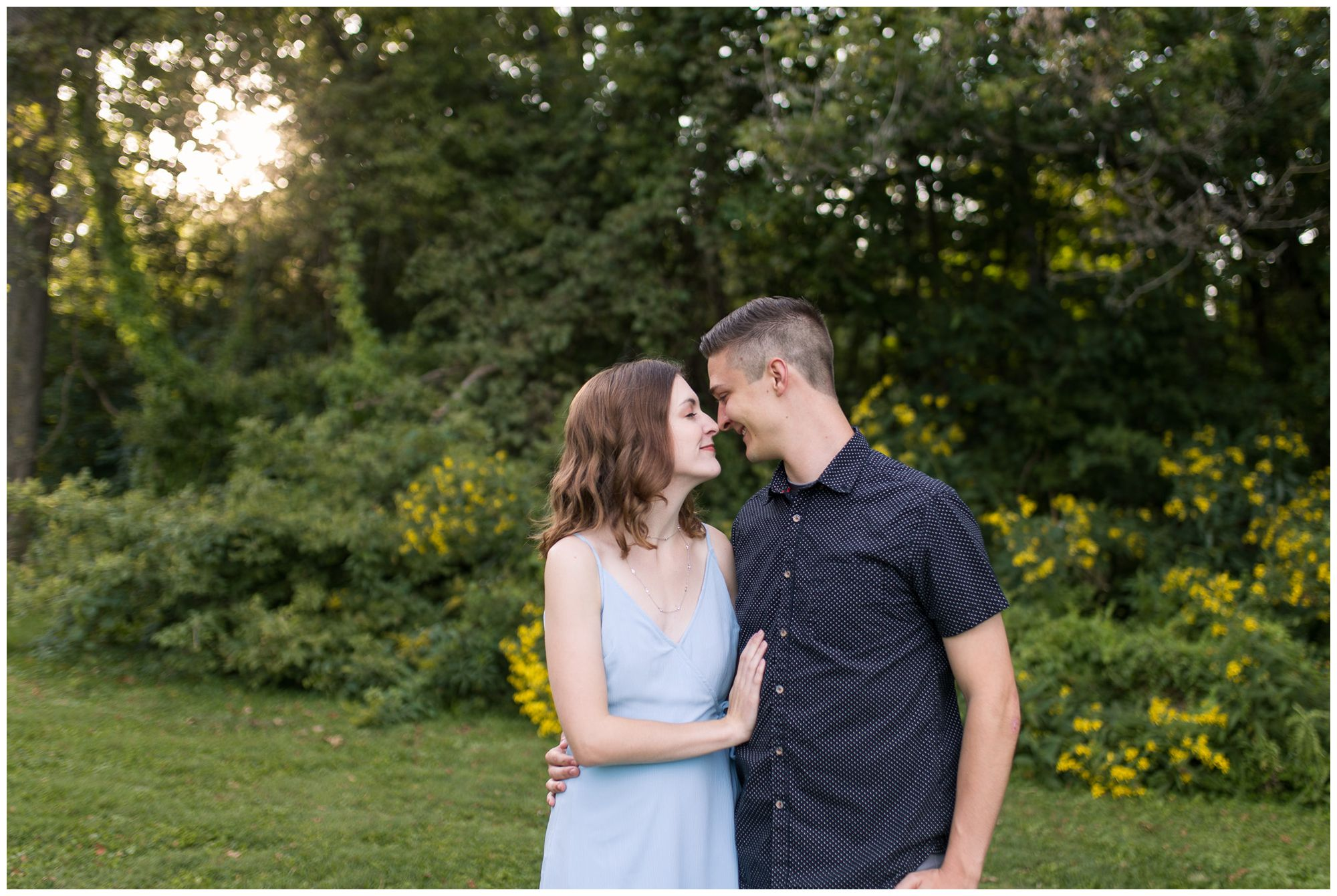 bride and groom touch noses during Fort Wayne engagement session at Foster Park