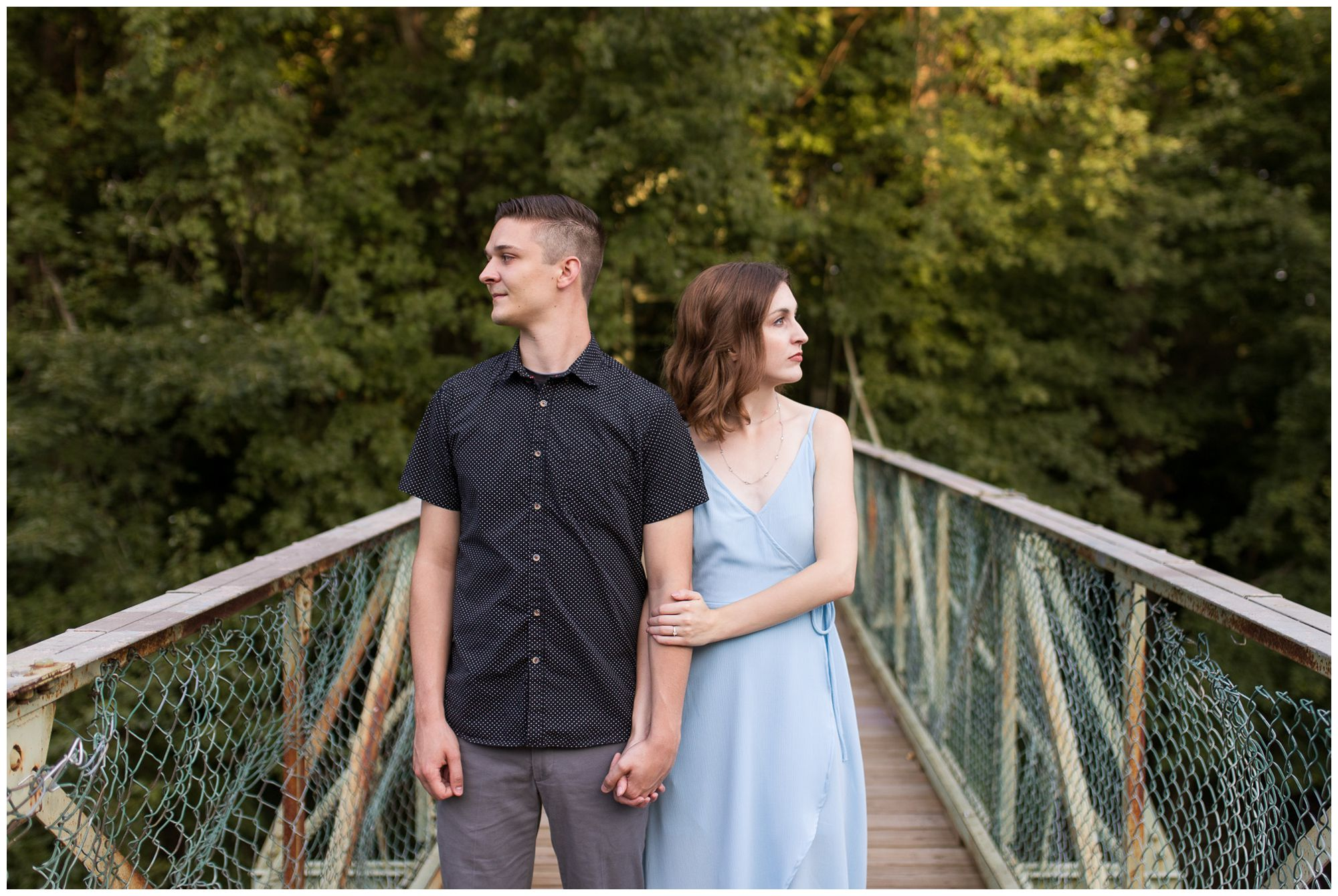 bride and groom hold hands between them and look away during Fort Wayne engagement session