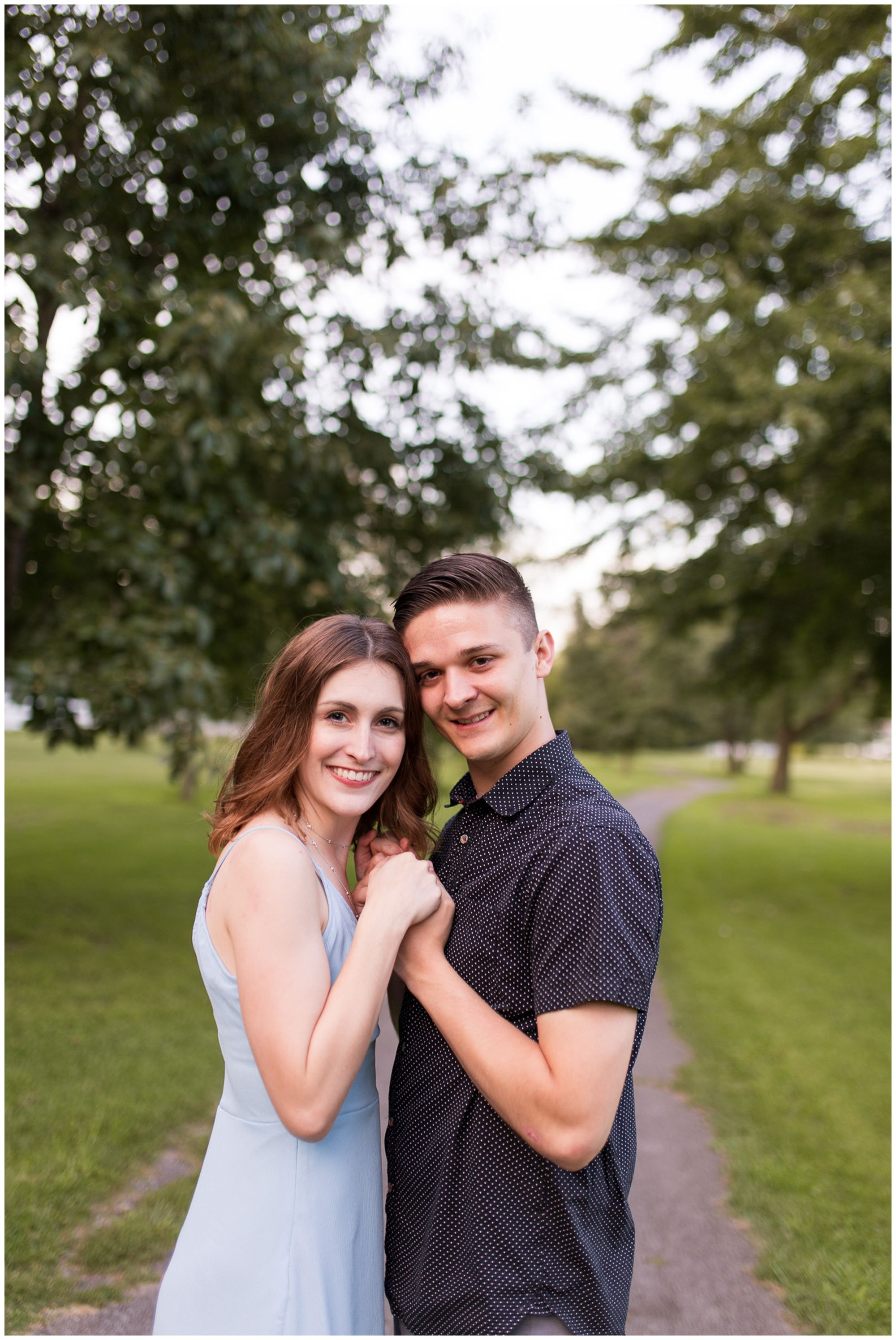 couple cups hands together during Foster Park engagement session in Fort Wayne, Indiana