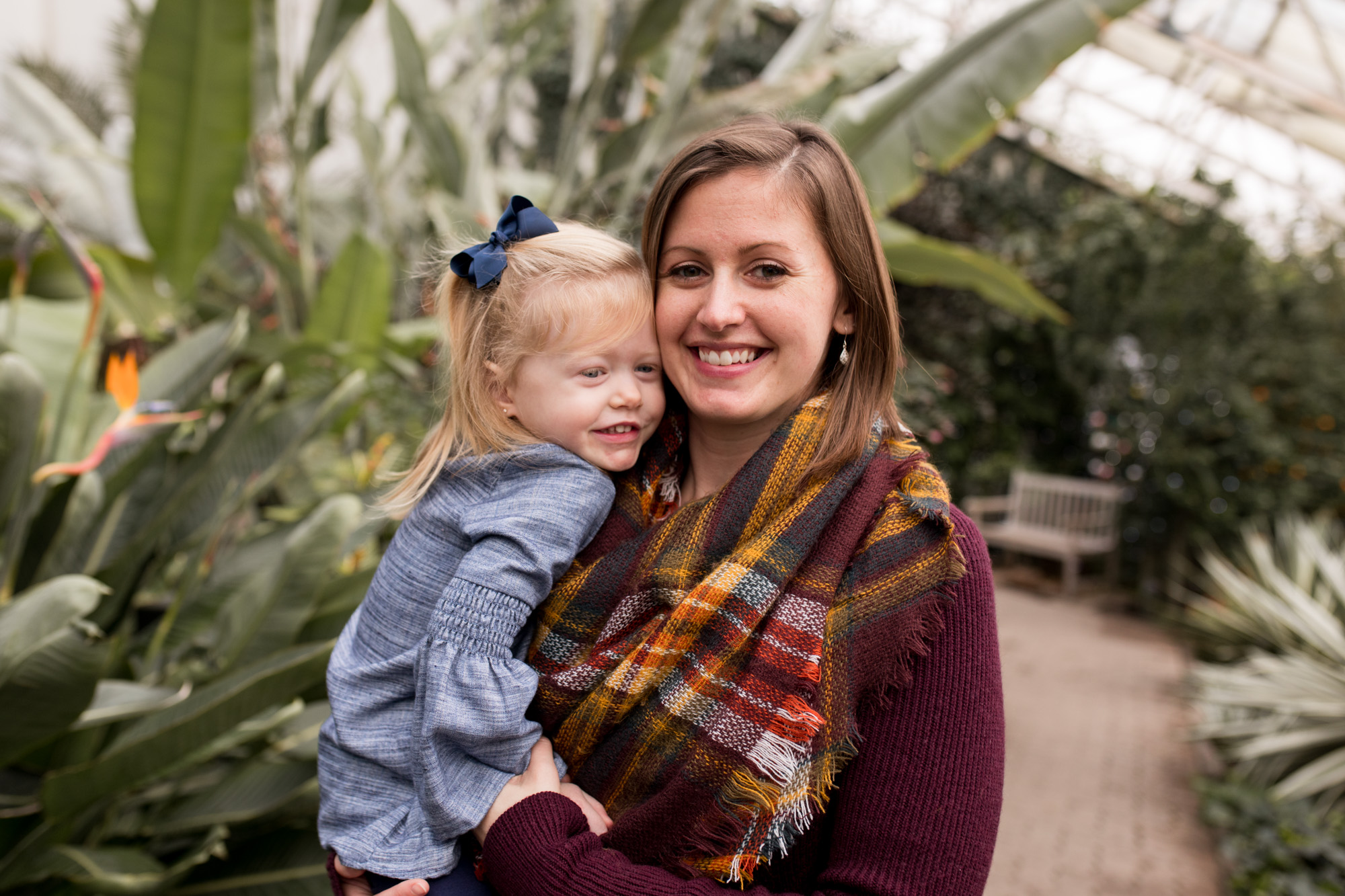 mom hugs daughter during Fort Wayne family session at Foellinger-Freimann Botanical Conservatory