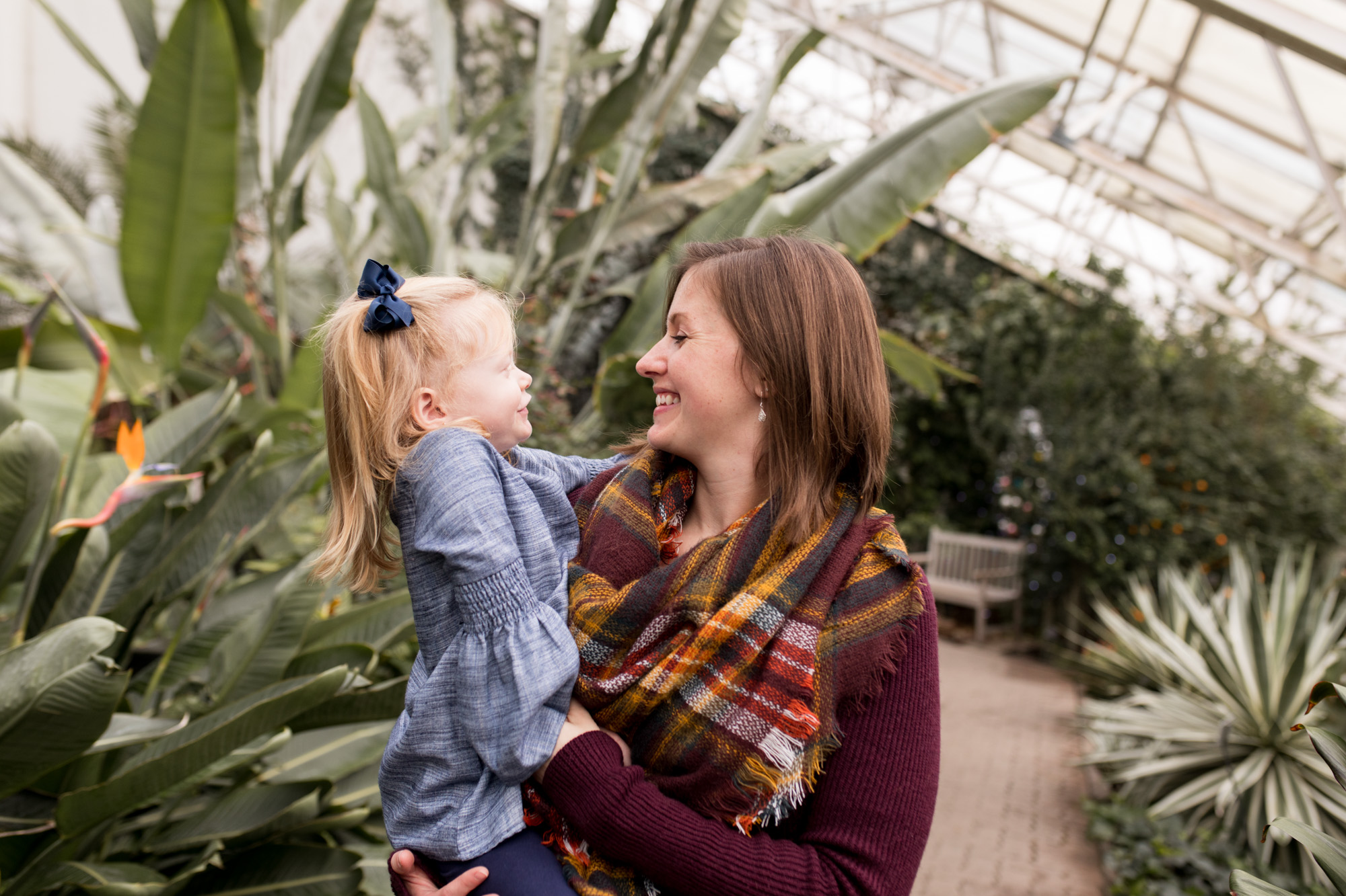 mom and daughter during family session at Foellinger-Freimann Botanical Conservatory in Fort Wayne Indiana