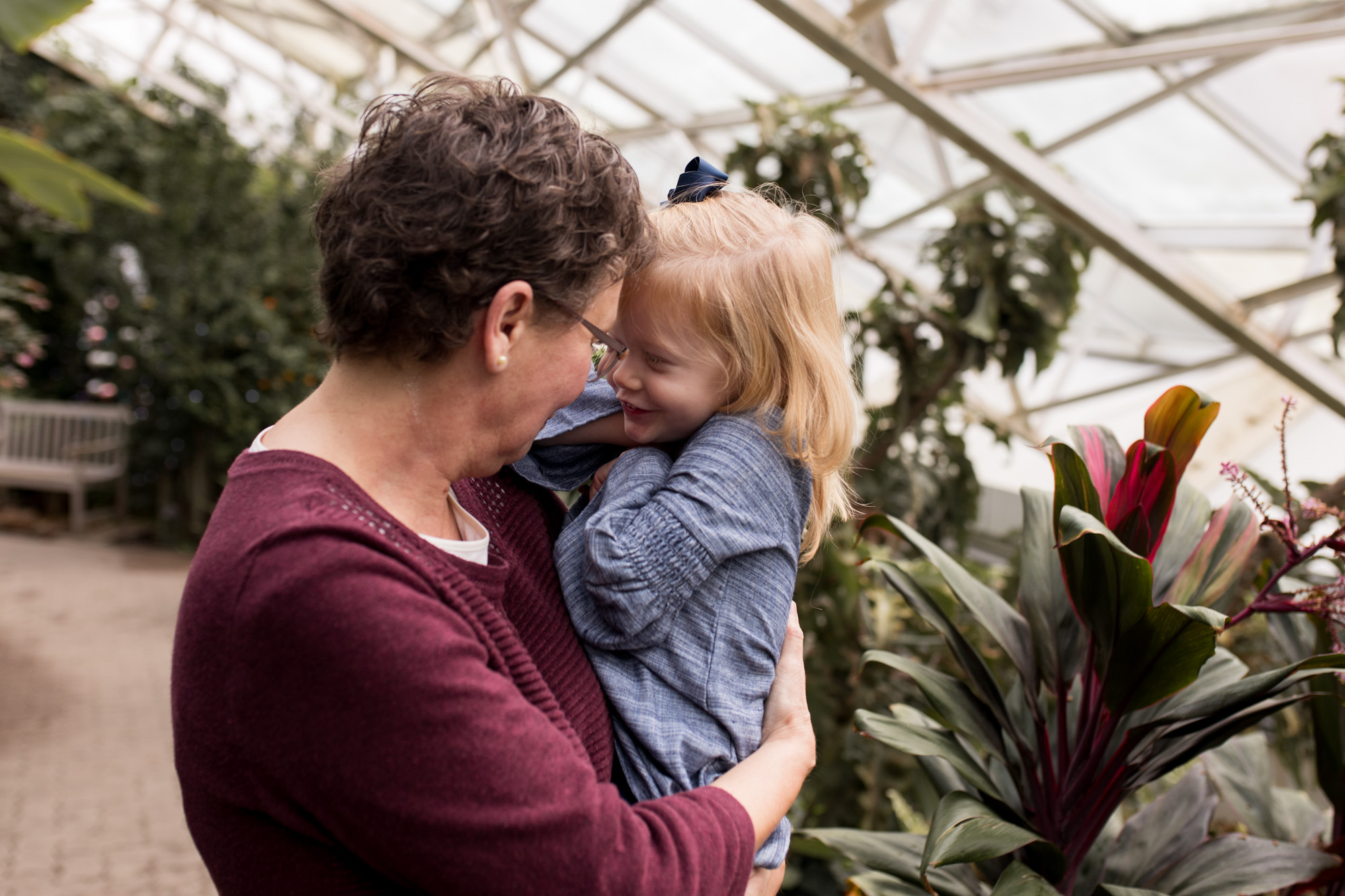 grandma and granddaughter during family photography session at Foellinger-Freimann Botanical Conservatory in Fort Wayne Indiana