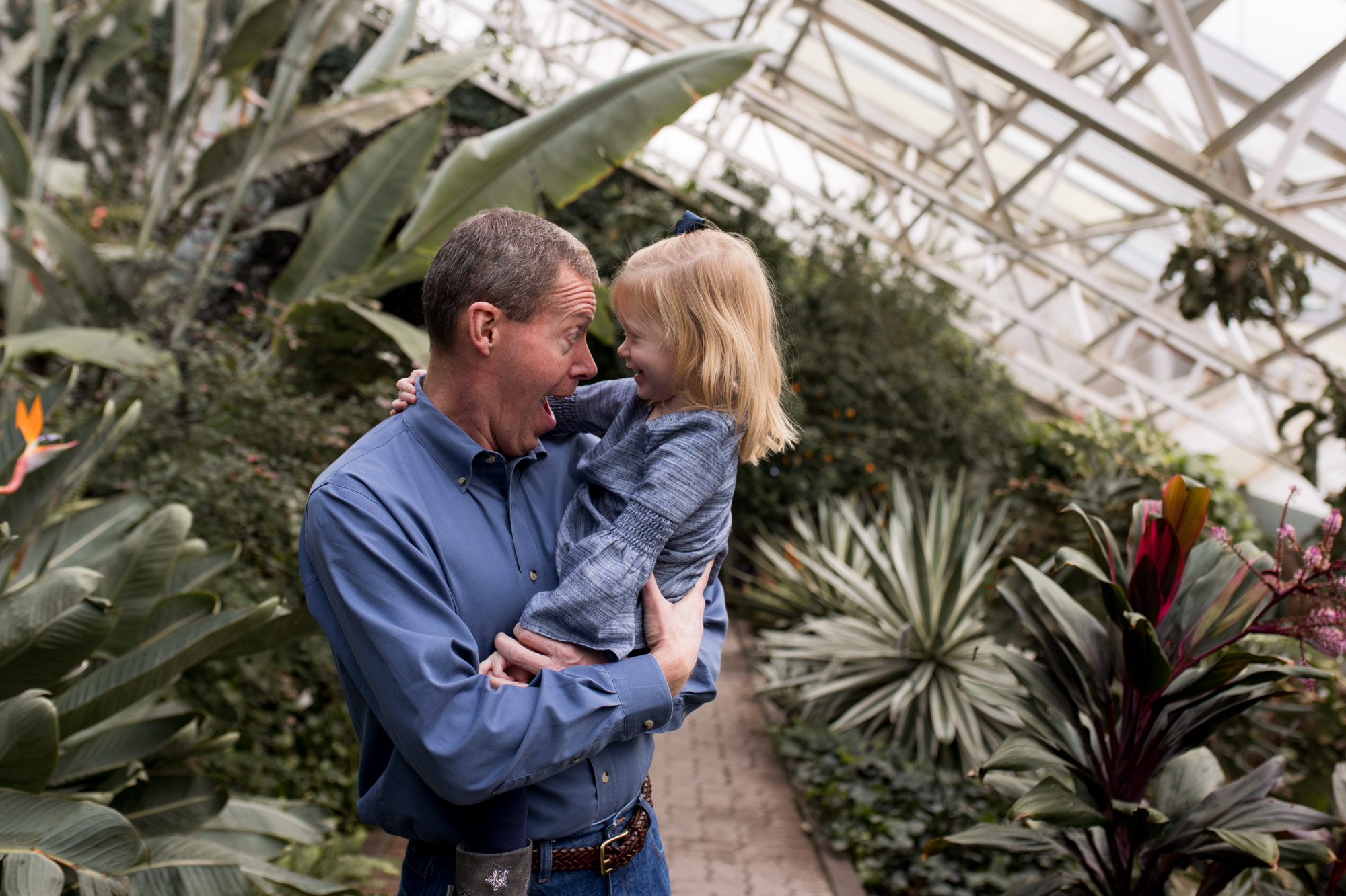 grandpa and granddaughter during family session at Foellinger-Freimann Botanical Conservatory in Fort Wayne Indiana