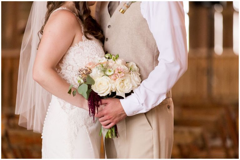bride and groom portraits with bride's bouquet at The Barn on Boundary in Eaton Indiana