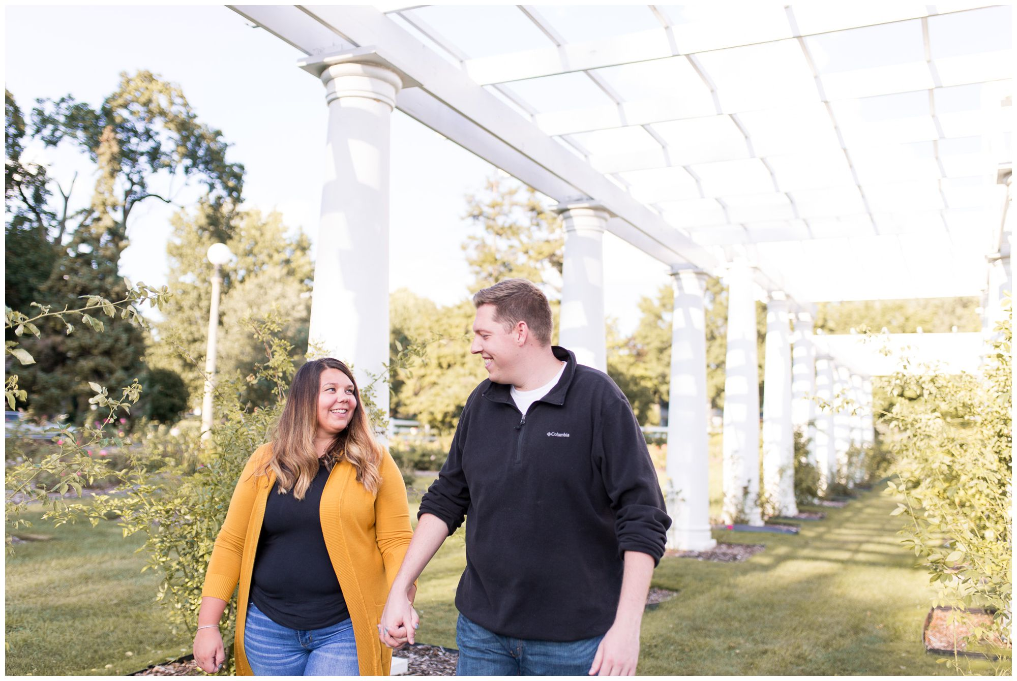 couple walking at Lakeside Park in Fort Wayne during engagement session