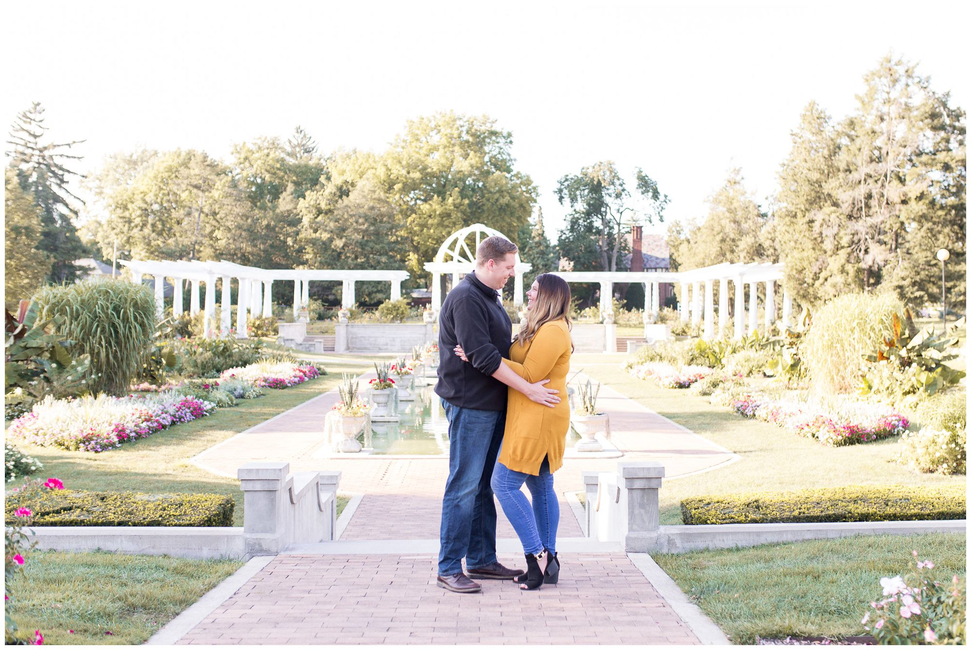 couple holding each other during engagement session at Lakeside Park in Fort Wayne