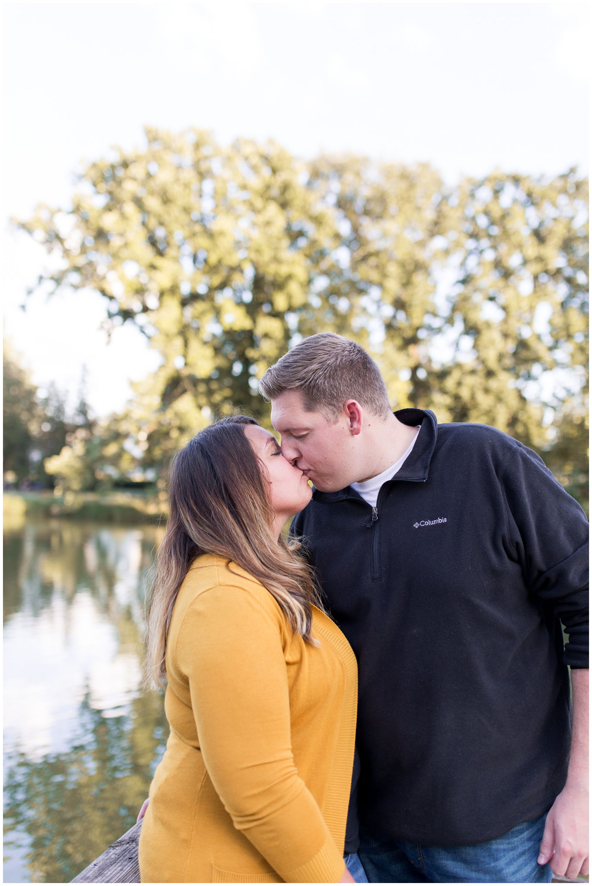 couple kissing during engagement session at Lakeside Park in Fort Wayne