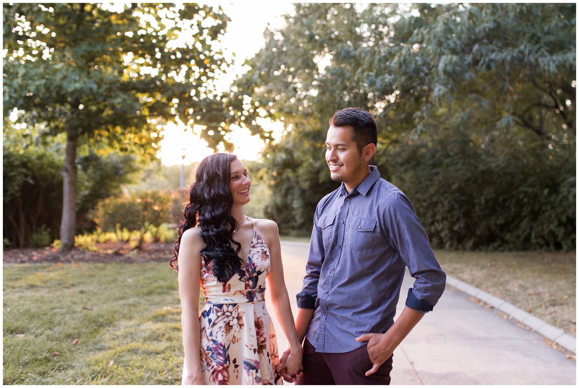 couple holds hands during engagement session at Headwaters Park in Fort Wayne Indiana