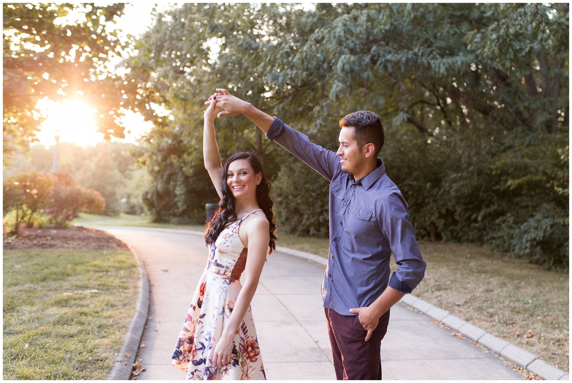 groom twirls bride during engagement session at Headwaters Park in Fort Wayne