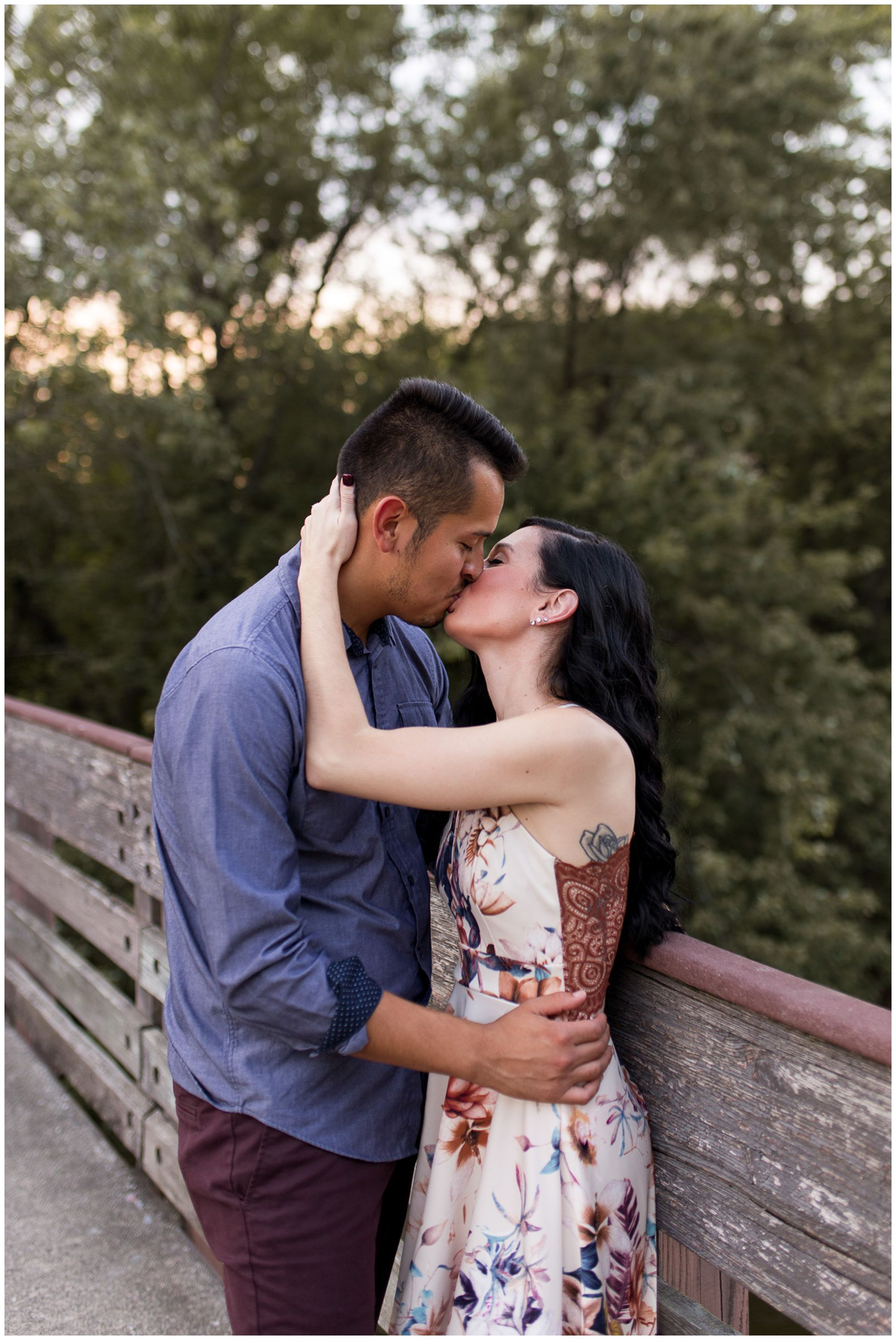 couple kisses during engagement session at Headwaters Park in Fort Wayne