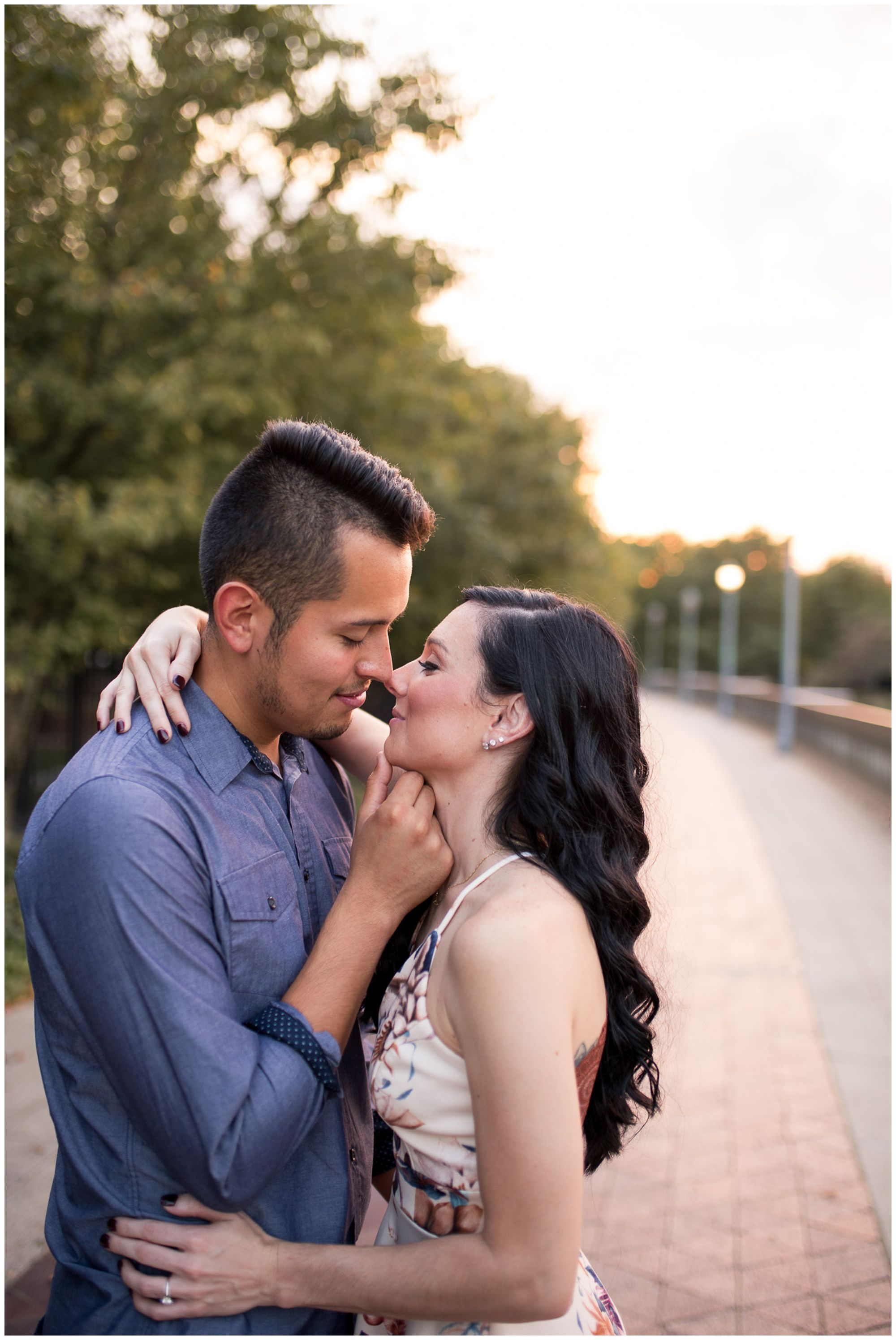 groom pulls bride in for kiss during Fort Wayne engagement session at Headwaters Park