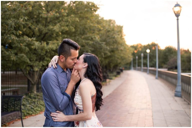 couple kisses during Fort Wayne engagement session at Headwaters Park