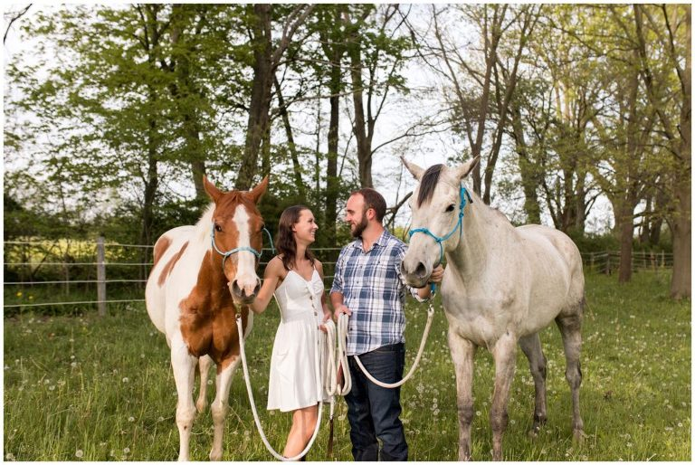 bride and groom with horses during engagement session in Indianapolis
