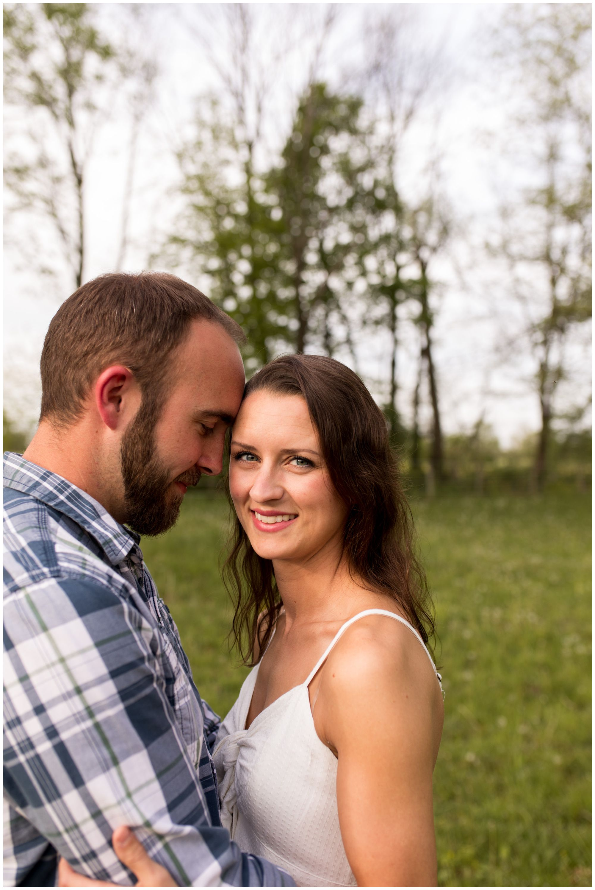 bride and groom during Indianapolis engagement session at horse pasture
