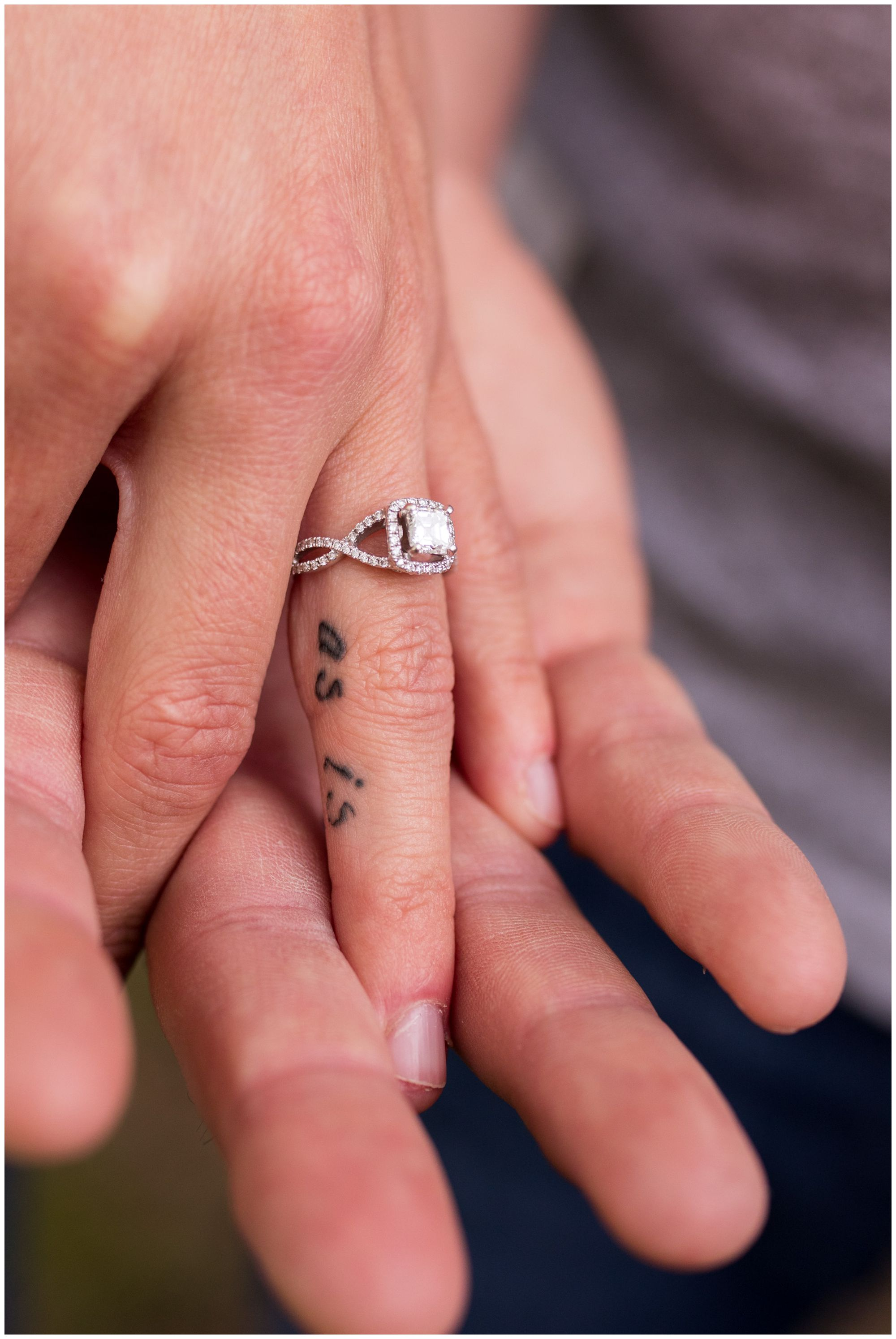 bride's tattoo on ring finger during Indianapolis engagement session
