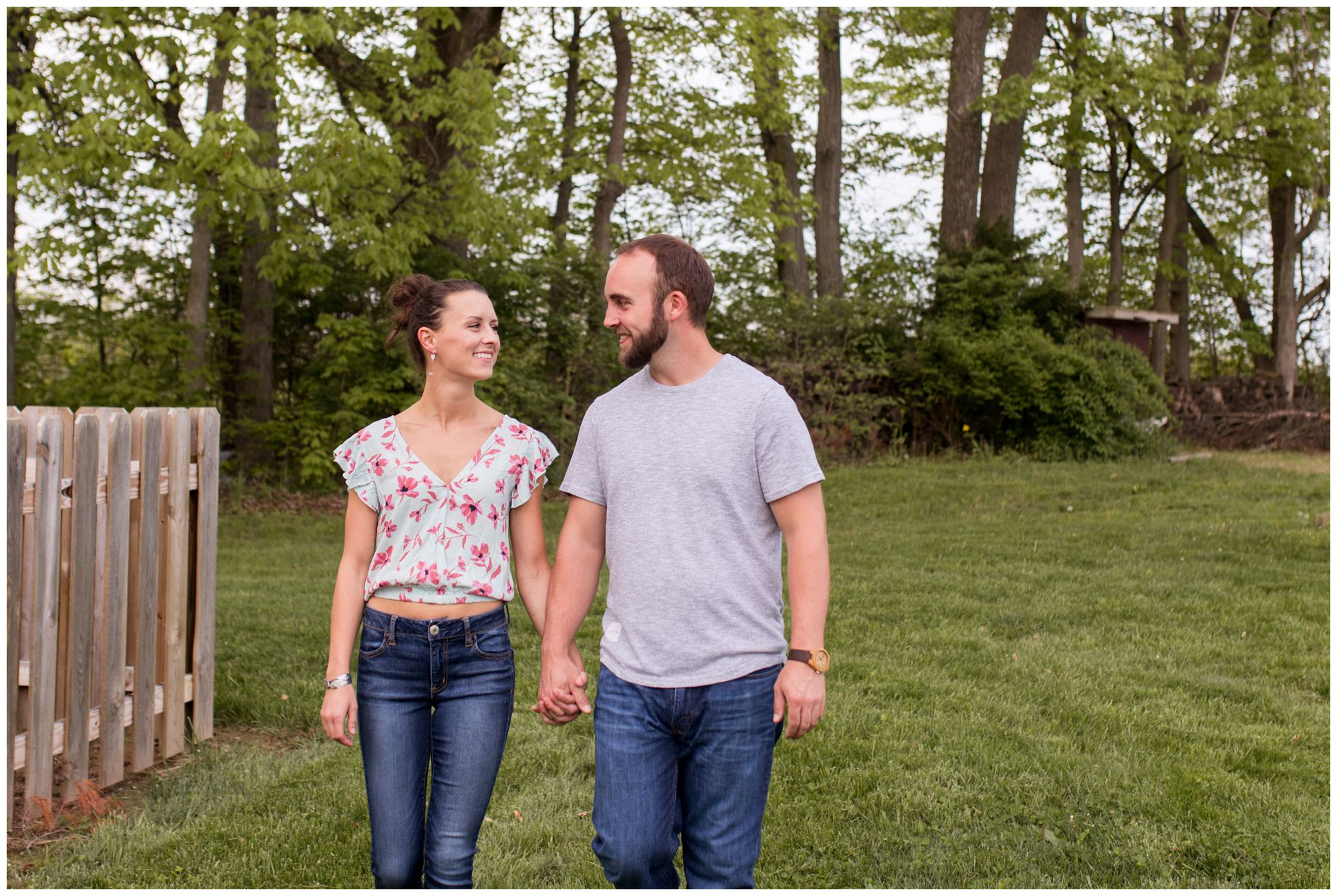 bride and groom hold hands while walking during Indianapolis engagement session