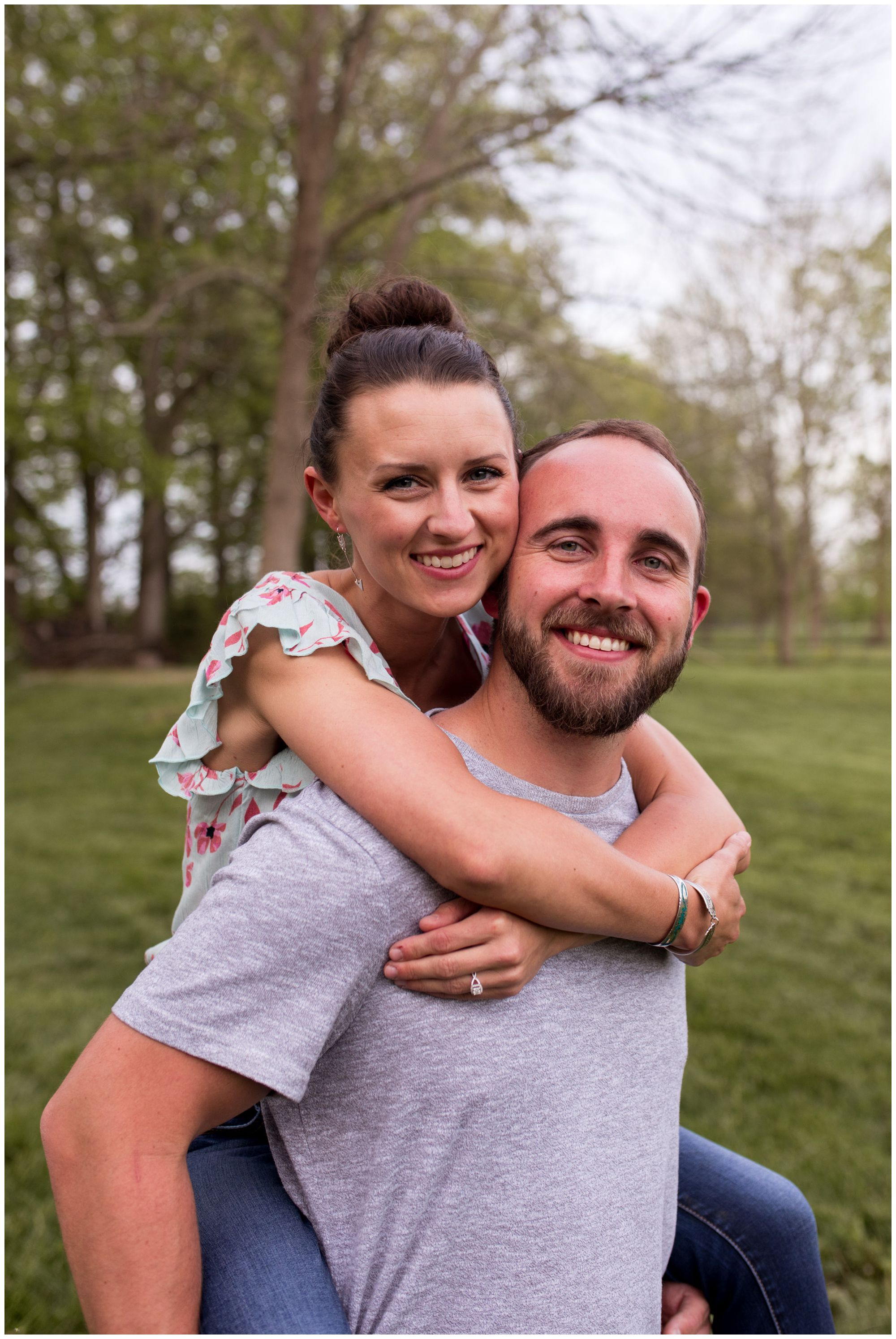 bride rides piggy back on groom's back during Indianapolis engagement session