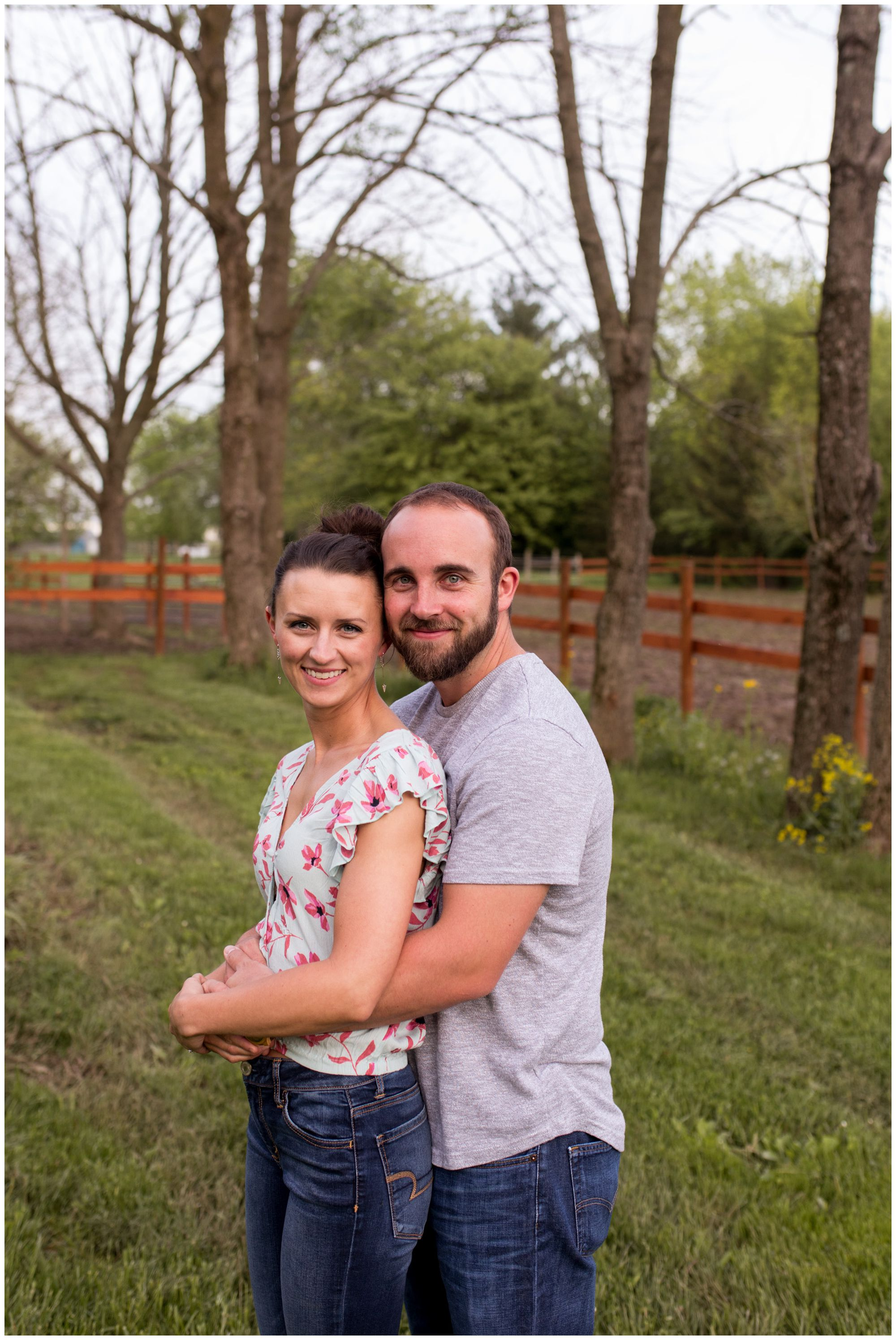 groom wraps arms around bride during Indianapolis horse pasture engagement session