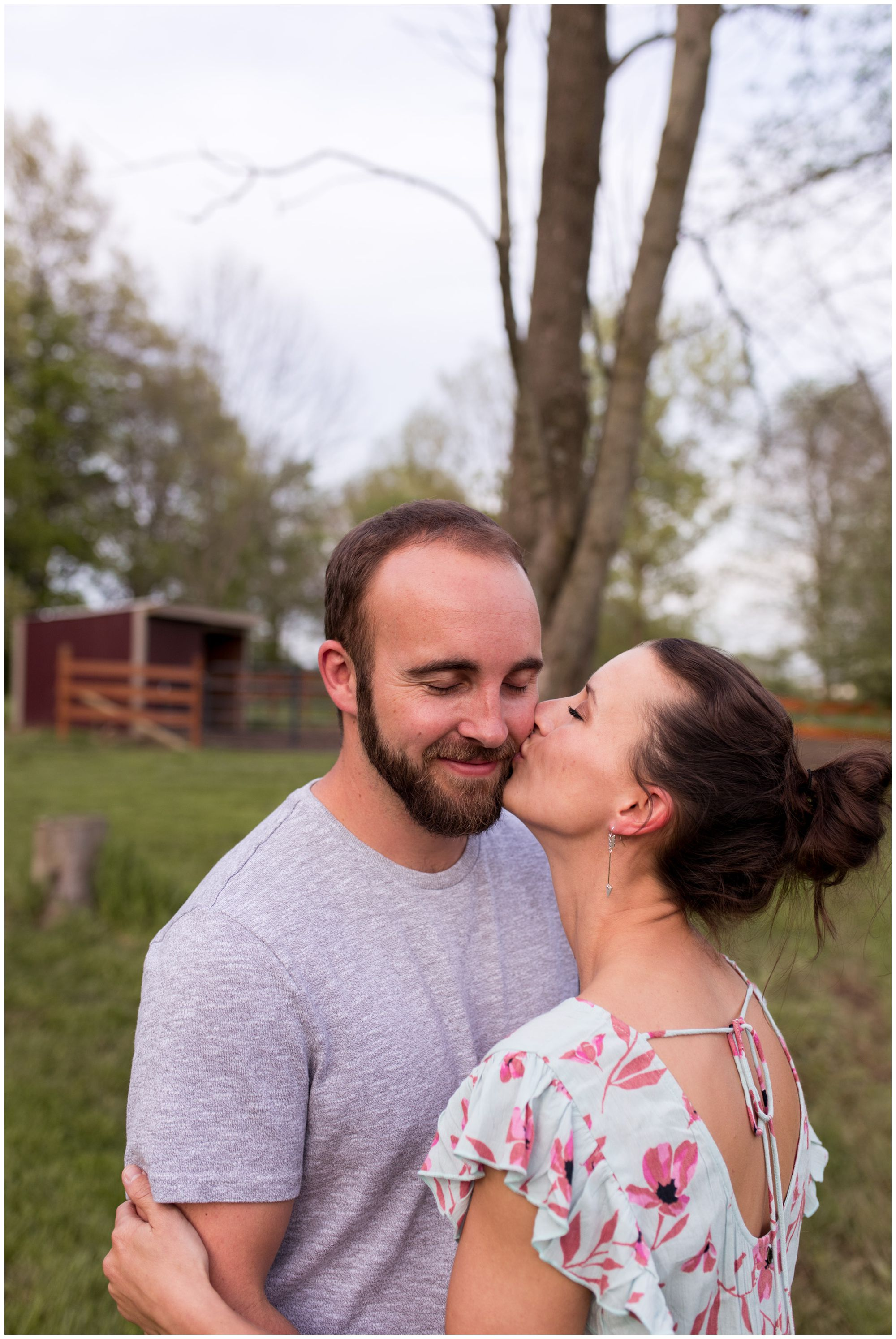 bride kisses groom on cheek during engagement session in Indianapolis