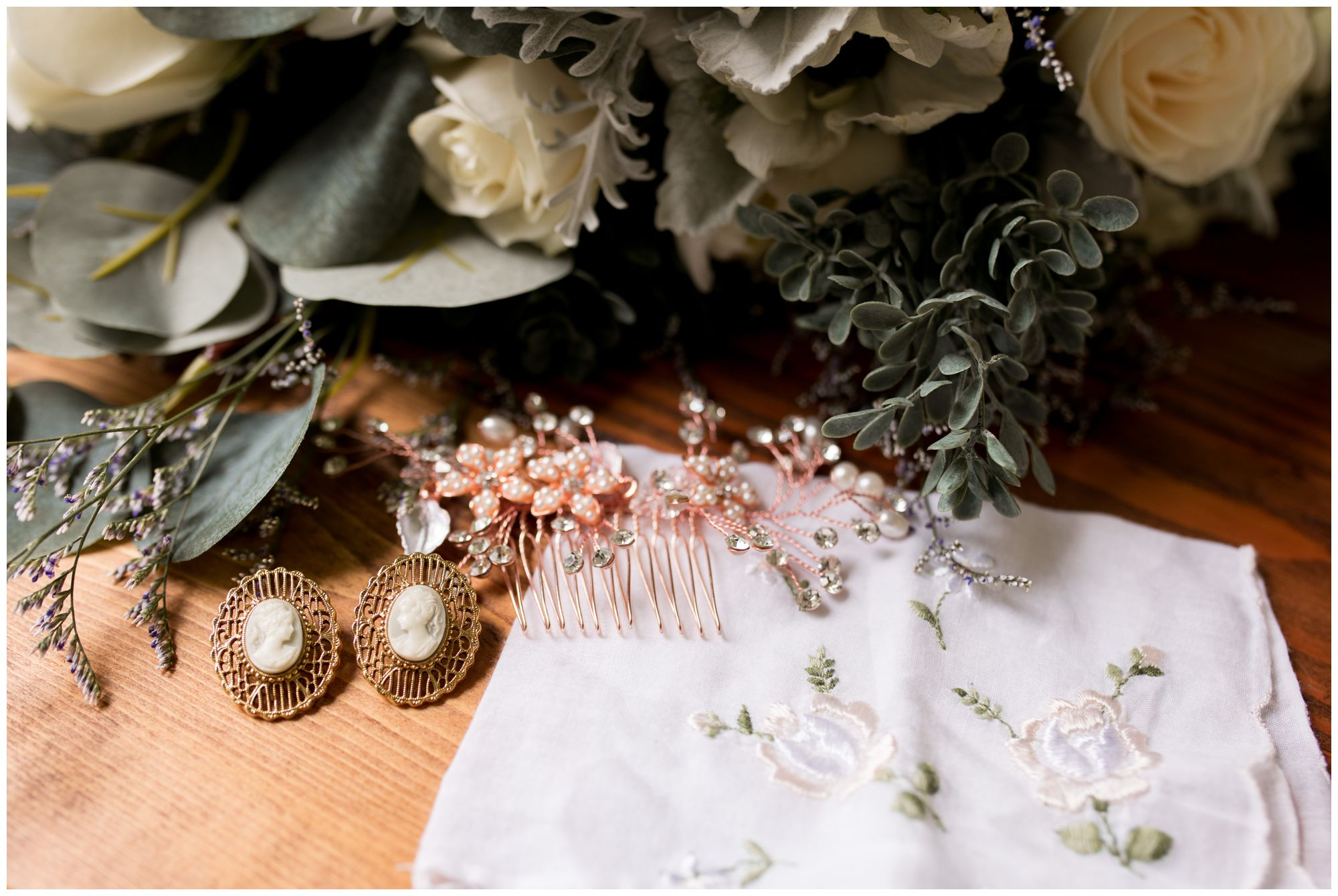bride's details of hair comb, earrings, handkerchief and bouquet before Muncie Indiana wedding