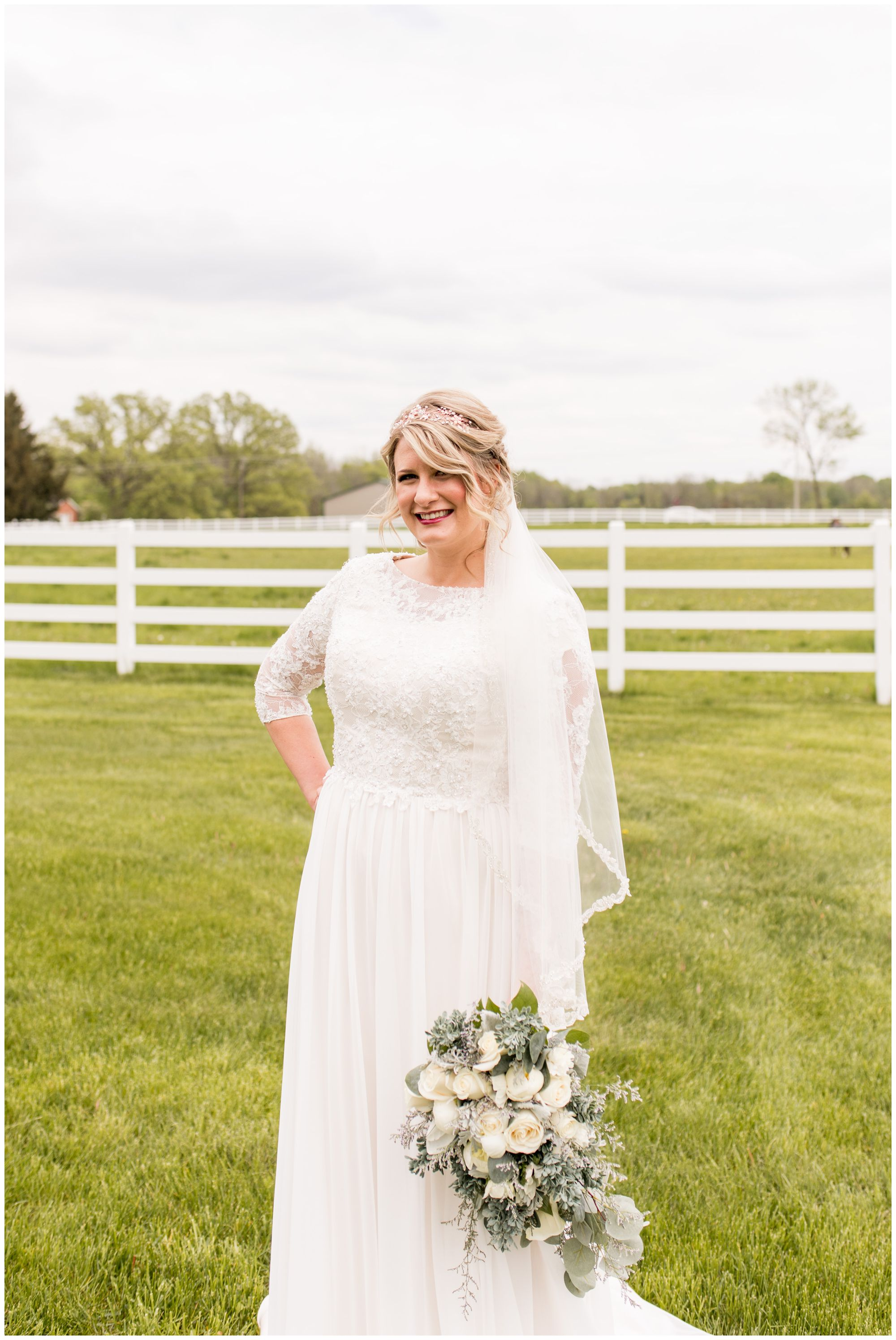 bride holds bouquet at side during bridal portraits before Muncie Indiana wedding