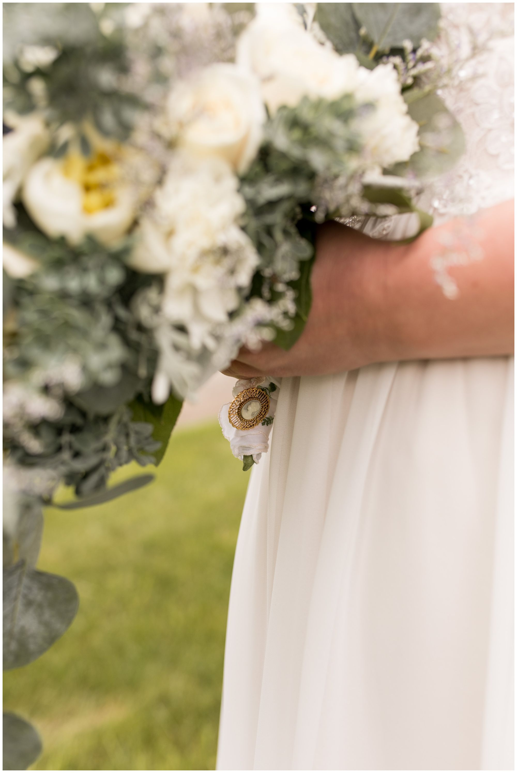 close up of bride's floral details before Muncie wedding ceremony