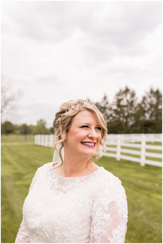bride beams before wedding ceremony in Muncie Indiana